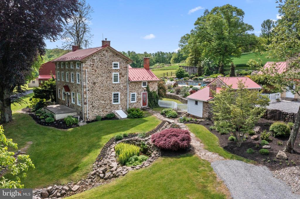An incredible opportunity to own a peaceful and private oasis in desirable Chester Springs! North Hill Farm is 64 acres and offers unparalleled privacy and stunning views of the countryside. A long drive leads you to an original circa 1797 Stone Manor home with an addition added in 1837. An incredible Copper Beech specimen tree is in the front of the home as you enter the property. The main house has 5 bedrooms and 3.1 baths. A large primary suite is on the second floor. On the first floor there is a living, dining room and smaller living room/den in the original section, which offer character and charm. Featuring original hardwood floors, deep window sills, built-in bookcases and 2 fireplaces with one being a woodstove. In a newer addition (expanded and renovated in 2001) there is radiant heat floor in the butlers pantry, kitchen and sitting room. Off the kitchen French doors take you out onto a porch to incredible stone walls leading to a pool with stone coping with incredible hardscape and gardens. There is a stone ruin that is a perfect location for additional outside entertainment. An oversized carriage house/garage has entry from the pool into a large pool house which has a half bath and great space to gather and relax. Upstairs is a large one bedroom apartment with a kitchen and dining/living room combo and expansive views of the pool, springhouse, barn and house. Below is a 3 car garage. For the equine enthusiast there is a large barn that could be converted to stalls below as well as a large space above for storage or an incredible party barn! Endless possibilities!! North Hill has been meticulously maintained. There is an PA Ag Land Preservation Easement which allows for commercial equine activities, as well as the opportunity to build another residence. The property is 43 acres of open land with the balance offering a stream and woodlands. Close proximity to shopping and school and easy access to major highways.