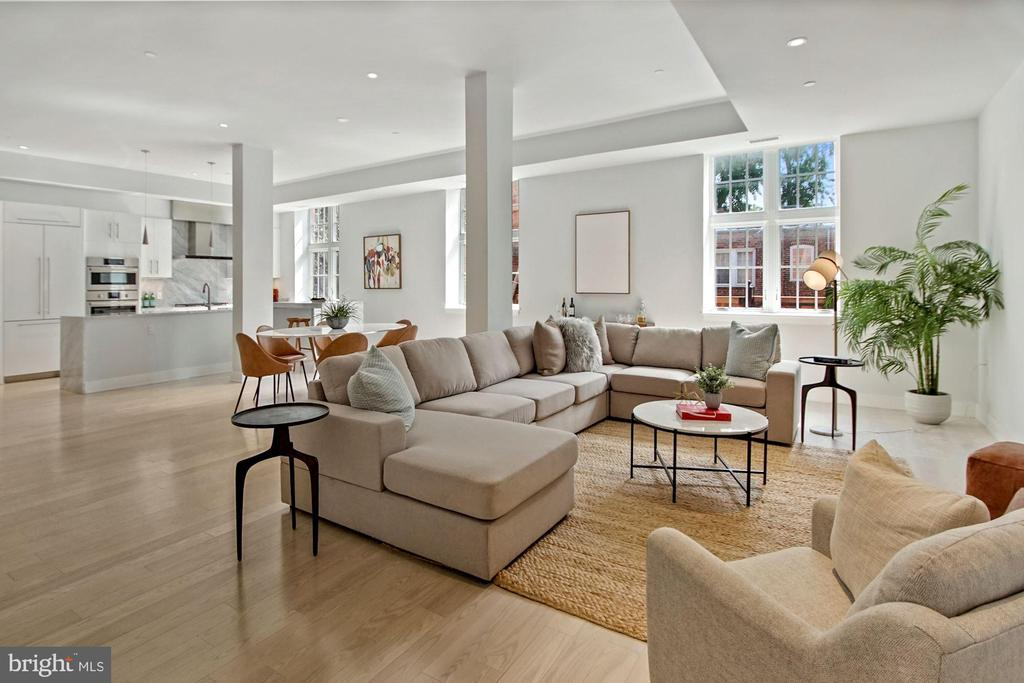 Rarely available and meticulously renovated 3BR, 2.5 BA condo in the highly sought East Village of Georgetown. This contemporary and open concept condo features over 2,100 square feet across 2 levels with wide-plank flooring, towering ceilings, oversized casement windows, Carrera marble counters, and Duravit and Kohler fixtures. The main level includes an expansive living/ dining area, an eat-in kitchen with high end appliances and Carrera marble counters and a powder room. The second floor has a gracious primary suite with a marble shower and soaking tub, two additional bedrooms, and a full bath.