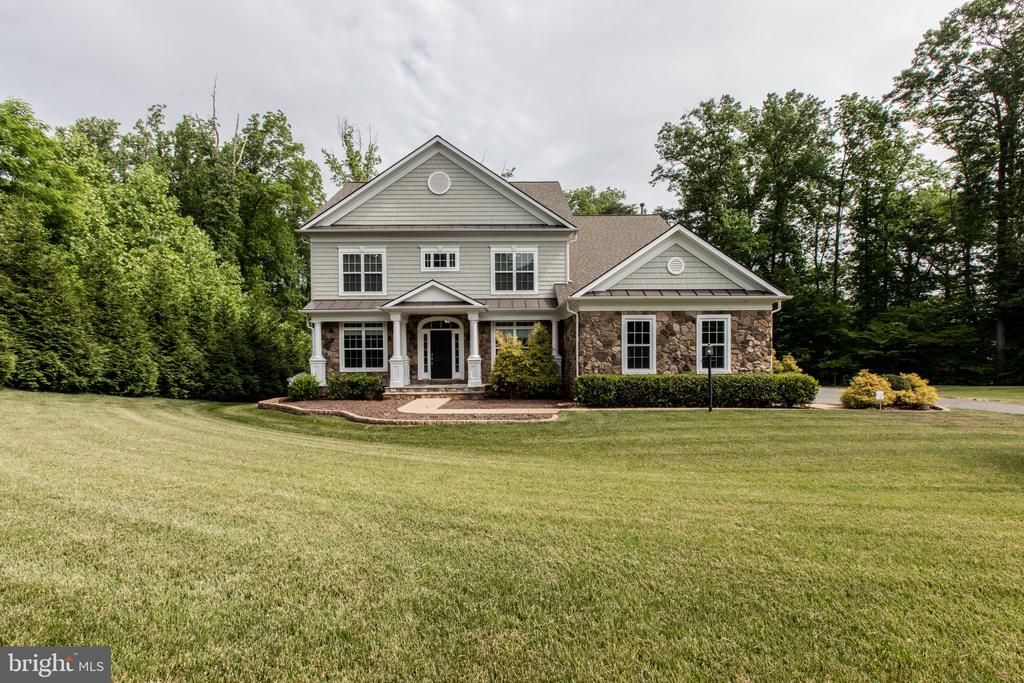 Elegantly nestled on a private 3.02 acre mature tree wooded lot . Peacefully sitting next to a creek in the exclusive Millstone At The Glens. Homes in this neighborhood rarely go up for sale. Now is your chance to own this exclusive property.  Large Open floor plan flooded with natural light, boasting  more than 5,200 square feet on three finished levels. Nine foot ceilings on all three levels with recessed lighting, crown, base and architectural molding throughout the main level. Custom window treatments, Installed 20K Generac standby generator,  huge three  car side load garage, three  extra 120 volt outlets with a  240 volt outlet in the garage with capacity to charge electric vehicles... and that's just a few of the  upgrades!  From the time you enter the front door, you are blown away by the shear amount of space on the main level. The main level is stunning with solid oak flooring, coffered ceilings, an amazing bumped out sun room with large format ceramic tiles off  the kitchen. Picturesque wood deck off sunroom with windows everywhere your eye can see. A stone front fireplace is the back drop for a spacious living room off the gourmet kitchen, featuring quartz counter tops, glass tile back splash , double oven, cook top, up and down kitchen cabinet lighting,  great kitchen island with breakfast bar, stainless steel appliances and new Bosch dishwasher. Working from home is a breeze with an office/ den right at the entrance and a secondary library  that can be used for a second office, yoga room, guest bedroom, meditation room or just about anything your mind can come up with. A perfect home for entertaining with a large dining room off the main entrance and kitchen. The entire property has been wired with new fiber optic surround sound/ceiling speaker system with HEOS amps on all three levels. New araknis home network featuring eight ethernet ports and two indoor wireless access points with speeds up to 1750 Mbps. And that's not all! The upper level features 
