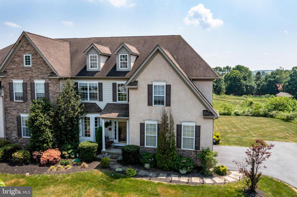 Elegance and beauty abound in this former model home in exclusive French Creek Village. This Beaumont model is situated on one of the largest lots in the community and overlooks the 6th hole of the French Creek Golf Club with breathtaking views of the twenty five open acres. Built to impress even the most discerning buyer, this gorgeous carriage house boasts an airy two-story foyer with detailed millwork, columns defining the adjoining sitting area, and hardwood flooring that flows throughout the main living level. The pleasing floor plan leads into a family room with a stone fireplace, vaulted ceiling, and an abundance of natural light. Adjacent to the family room is the exquisitely designed kitchen, complete with granite countertops, 42'' Century cabinets, center island, upgraded appliances including a double oven, and a breakfast area with sliders to the deck where you can enjoy the truly spectacular views! When it is time to entertain, the large formal dining room can accommodate a dozen of your closest friends. The mostly finished, multi-functional walk-out lower level offers an additional 1,100 sq. ft. of living space boasting a wet bar kitchenette and full bathroom, making it a great overnight space for guests or even a semi-private multigenerational living quarters. High ceilings and tons of natural light make this space feel open and inviting, not to mention the glass sliders that lead outside to your own private golf course view. When it is time to retire from a long day at the course, the luxurious master bedroom features crown molding, a sitting area, walk-in closets, and an en-suite spa-like bath with elegant tile work, glass-enclosed shower, separate tub, dual vanity, and water closet. Three generously-sized bedrooms, a hall bath, and a large open loft area with endless potential complete this level. There is so much to love about this home including copious amounts of storage, public water and sewer, convenient first floor laundry, built-in stereo sou