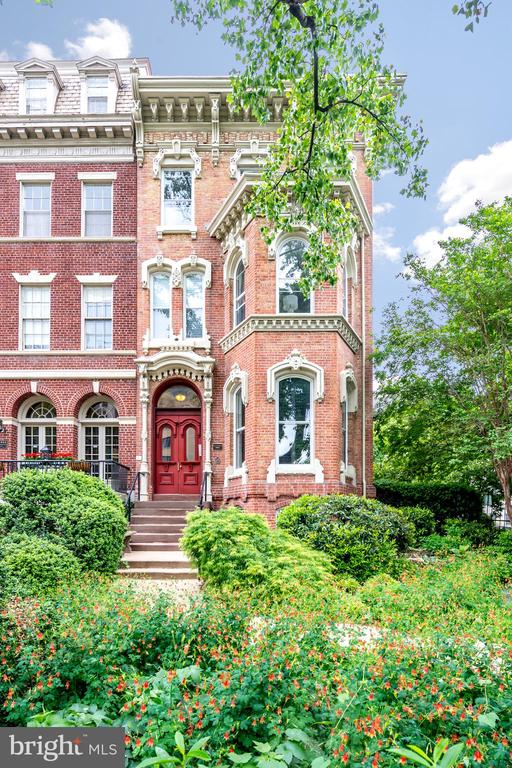 Recently featured in the NY Times! Welcome to 1601 16th St NW Unit 2, where history meets luxury in the Heart of Dupont! This beautiful 2BR/2BA condo was substantially renovated in 2017 and features all the modern finishes while still preserving the elegance of the original Victorian mansion that dates back to 1850. Entertain guests by the fireplace in the open living area. A PRIVATE BALCONY off the back of the residence provides an idyllic refuge for a cup of morning coffee or a glass of wine to wind down the evening. The immaculately updated gourmet kitchen is complete with a Thermador wine fridge, KitchenAid SS appliances, custom cabinetry, and Caesarstone quartz countertops. The spacious primary bedroom is the height of luxury, highlighted by its own fireplace, sitting area, custom walk-in closet, and en-suite bathroom with double vanity. The second bedroom also has its own private bath. Both bathrooms have been renovated with bespoke cabinets, new fixtures, recycled 19th century brick flooring, and glass-enclosed showers. South and west-facing, fully restored, original windows offer ample natural light throughout. Red oak hardwood floors, 10-foot ceilings with recessed lighting, and an in-unit laundry room complete the space. 2-car PARKING (1 separately deeded garage space and 1 surface space) with ADDITIONAL STORAGE INCLUDED! Perfectly located within a short walk to all the excitement and charm that the Dupont, Logan, 14th St. neighborhoods offer.  Property is available for private tours.