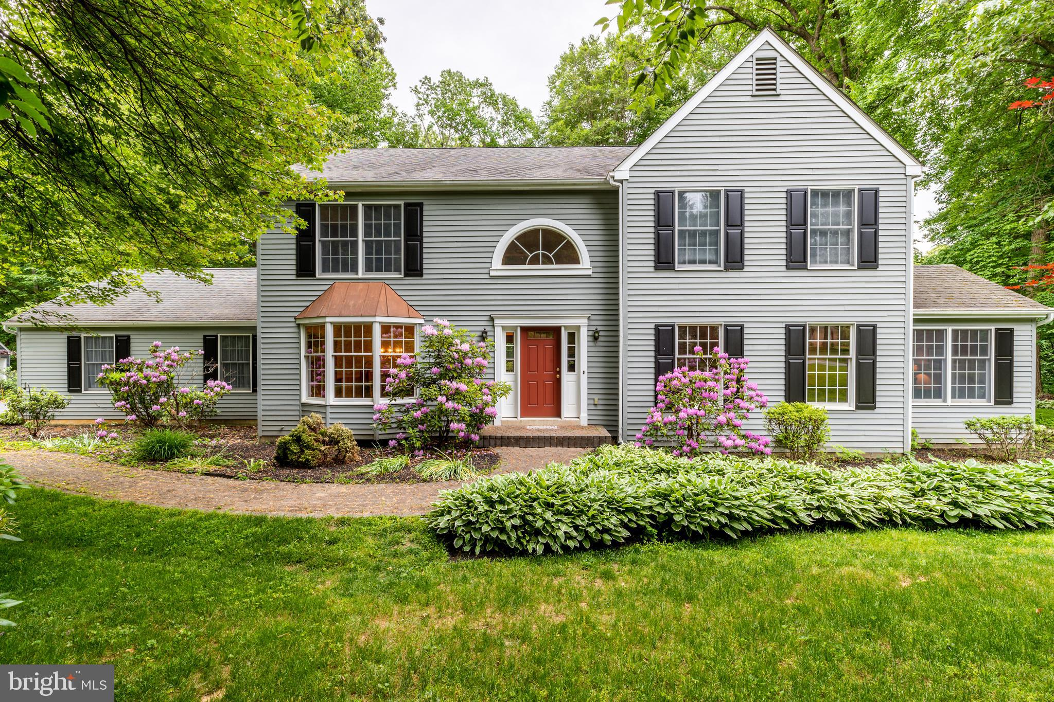 This is the one you have been waiting for!  Situated on a flat, one acre lot near the end of a cul-de-sac in the award-winning West Chester Area School District, this lovely 4 bedroom, 2.5 bath home is sure to please.  Enter the dramatic 2-story foyer where you will notice a stately L-shaped staircase and hardwood floors which flow into the dining room on the left and the living room on the right. The formal dining room is bathed in light from the bay window while the light filled living room boasts a wall of beautiful built-in bookcases.  Continue through the living room where double doors open to a spacious office with multiple windows providing an abundance of natural light. The heart of the home is  outfitted with plenty of cabinetry and a large island, all with granite countertops. The kitchen opens into a cozy family room complete with a stone fireplace and a wet bar. Sliding glass doors in the family room lead to a newer composite deck overlooking a park-like backyard. The laundry/mud room can be accessed from the kitchen, the 2 car garage, as well as the backyard. An upgraded powder room completes the first floor. Head upstairs where you will find three spacious bedrooms with ample closet space, a hall bath with a dual vanity, and the owner's suite. The stairs, hall, and three of the bedrooms feature newer neutral carpeting. The expansive owner's suite, with its vaulted ceiling, is complete with a generous walk-in closet, an additional closet, and an ensuite bath featuring a newly renovated tile shower, new granite vanity top, and mirrors. The basement is partially finished with a built-in bar for additional living or entertaining. This level also features tons of space for storage.  The entire exterior of the home was painted in 2016. As an added bonus for dog lovers, the backyard is invisible fence ready. All of this is perfectly located in the very desirable East Bradford Township, just a few minutes from the borough of West Chester with its quaint shops 