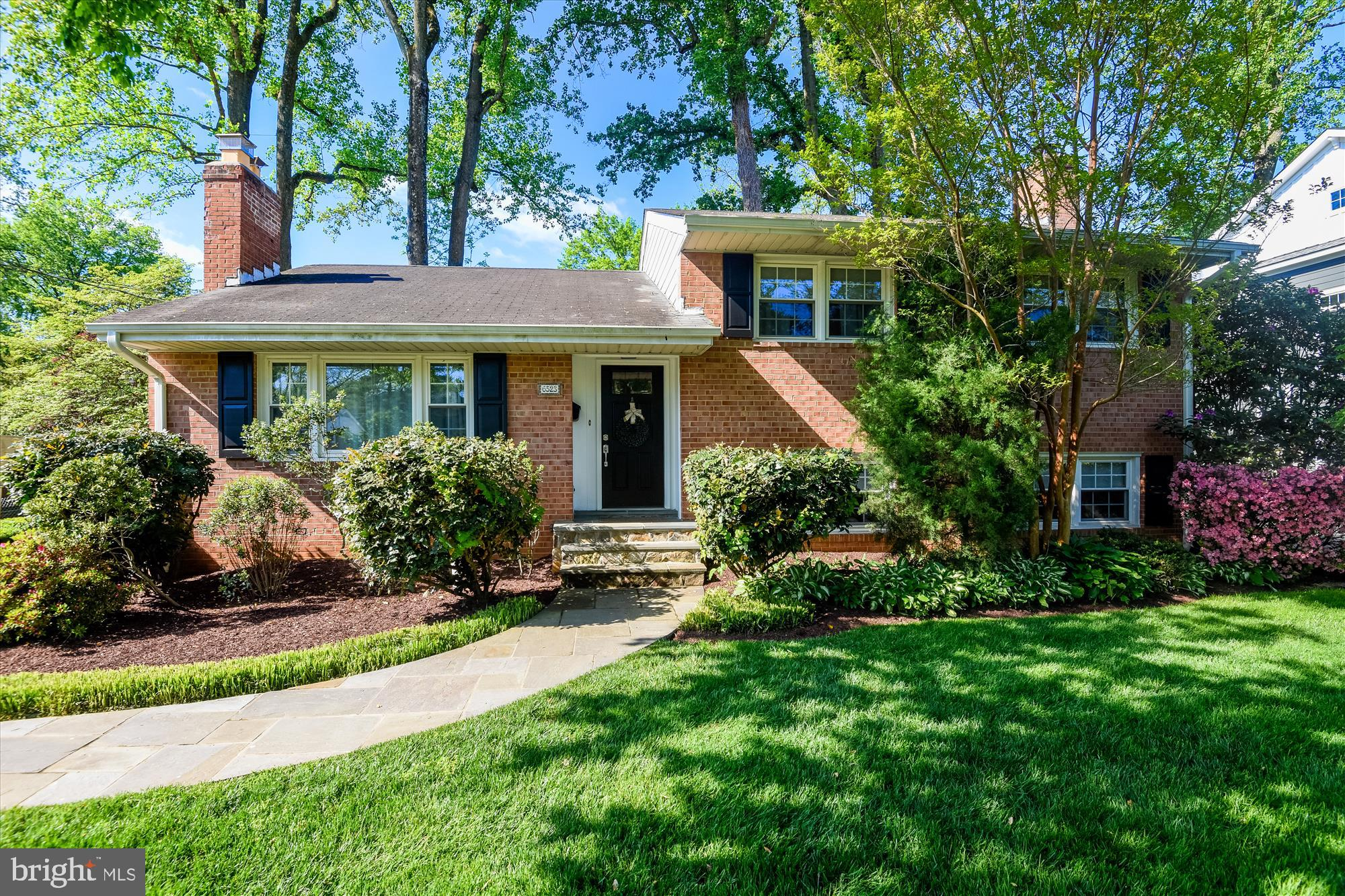 Beautifully maintained 4-level split in McLean! The lot is 11,172 sq ft and features well cared for landscaping, long driveway, mature trees, storage shed, and lots of beautiful flowers. The brick home has been appointed with black shutters and a matching black door for some modern curb appeal. Inside the front door you'll be greeted with hardwood floors, crown molding, a foyer open to a living room centered on a gas fireplace with mantel, which opens to a large dining area and renovated kitchen. The kitchen is large in footprint, features a skylight and bay window for lots of natural light, electric range with downdraft, stainless steel appliances, ample cabinet space, and counter space. The dining room leads to a large deck with lights. Upstairs you'll find a primary bedroom suite with closet, rarely found large bathroom with glass enclosed shower and double vanity. The 2 other bedrooms share a renovated hall bath with tub. There's a linen closet with a laundry chute! Hardwood floors can be found in the upper level as well. The lower level features newer carpet, a well light, mostly above ground rec space surrounding a wood burning fireplace with a white brick hearth. There's a bedroom with large closet and full bath on this level as well with storage closets and exit to the backyard.  The 4th level is also carpeted, features the utility and laundry rooms, each with additional storage space. There's a sump pump with a battery backup as well. This space makes a great rec room, office, gym, play room, or anything else you might need! Updates include HVAC (2010), Water Heater (2010), Dishwasher, Washing Machine, Front and Back Door,  Gutters, Skylight, kitchen backsplash, shed roof, renovated hall bathroom, carpet, and windows. Quiet dead-end street, but close to Downtown McLean. Enjoy Balducci's, Restaurants, McLean central park, library, easy access to Tyson's, 495, 66, or 267. Lots of McLean events year round like McLean Day, Winterfest, Farmer's Market, events at