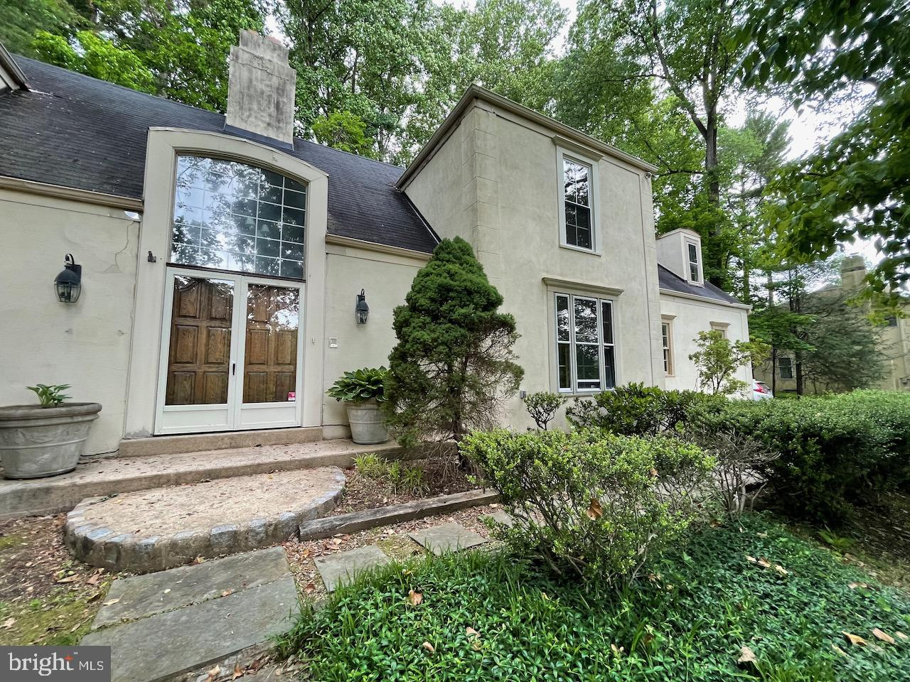This house is located in Newtown Square and is convenient to Route 3 and Route 476 and waiting to be restored to its once beautiful condition.  This is a 4 bedroom,  2.5 bath french country colonial-style house nestled in the hillside on Hansell Road.  There is an open flow to this contemporary floor plan which has hardwood floors throughout the first floor as well as upstairs in three of the bedrooms.  This house needs some attention to the details that once made it a beautiful home but worth the effort.  Visitors entering through the front door are greeted with a two-story foyer and ceramic tile floors, there is a large spacious formal dining room to the right and a large spacious living room to the left with a fireplace and doors leading out to the enclosed porch and backyard.   The kitchen was once updated with Corian countertops but needs a fresh approach to the fine details fitting for this type of home.   There is an informal great room with its own fireplace, built-in cabinets, and a  vaulted cathedral ceiling that exposes the second-floor landing separating the master bedroom from the three other bedrooms.  The master bedroom has a walk-in closet and its own full bath while the other three bedrooms on the opposite side of the landing area have their own hall full bath.  The backyard is secluded from neighboring properties by tall mature trees and has a flagstone patio and an enclosed porch.   Newtown Square is a suburban setting convenient to the amenities of modern life in and around the Philadelphia area.  Schedule your showing today and get to work on making this property your new home? This property is now active in an online auction. All offers must be submitted through the property's listing page. The sale will be subject to a 5% buyer's premium pursuant to the Auction Terms and Conditions (minimums may apply). All auction bids will be processed subject to seller approval.