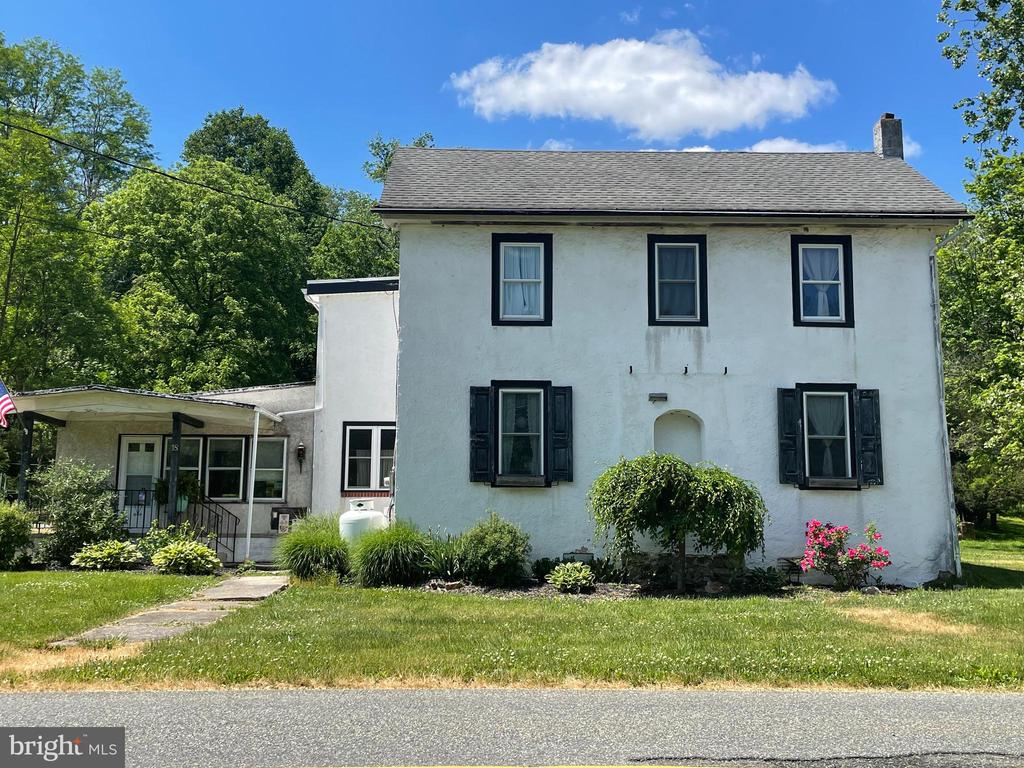 This spacious inside and out 1840 farmhouse on 8.18 Acres.  Features a detached 3 bay plus bank barn garage with a partial floored second level and a 20 x 40 second building with separate 200 amp commercial electric service.  The original portion of the farmhouse showcases beautiful deep window sills,  set off with rounded insets, wide plank board flooring.  The kitchen is the heart of the home and has been renovated with an abundance of cabinets and three pantry areas.  The second floor has a very large master bedroom with large full bath and also a walk in closet, a second bedroom with a half bathroom and a third bedroom.  Also on this floor is an additional open area that could be suitable for a fourth bedroom or an upstairs office or second floor tv room or reading lounge.   The main floor laundry / mud room area with half bath and easy access to the main floor full bathroom makes it easy to clean up after anything the outside activities can bring on.. The house has many additional closets both on the first floor and the second floor, built in shelving in both floors and  spacious foyer areas providing plenty of space and storage. The homes heat, hot water and air conditioning are all run by a geo thermal unit and instant hot water to the kitchen are a few of the updated amenities.   The large family room is centered around the corner wood stove.   Outside you have the above ground pool and deck area, rear patio, stream, full tree line and beyond that several acres of open pasture.  The possibilities are endless both inside and out.  While the home has been well maintained and updated there is still pleanty ahead to make this home your own.   The garages will meet so many needs Do not hesitate to get your showing scheduled today..
