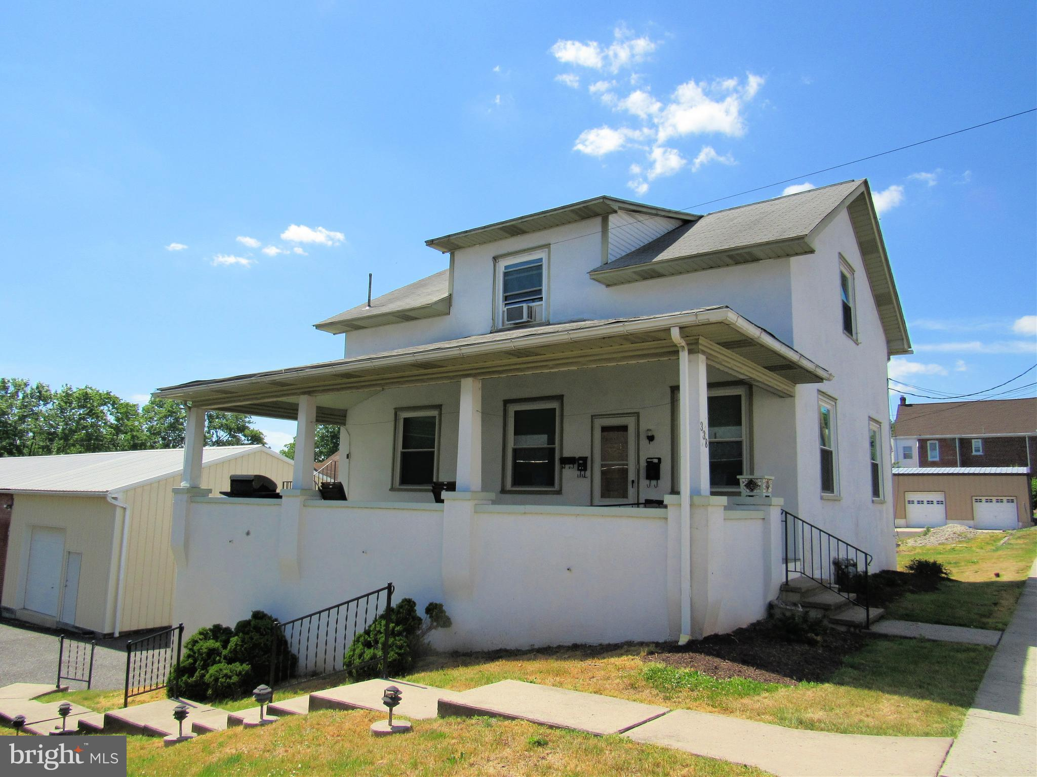 Great opportunity in this triplex plus rear light industrial rental.  Residential tenants pay electric and heat.  Rear light industrial tenant (Knoll International) pays all utilities.  Extra income from coin operated washer and dryer in basement.  Propety has been maintained very well.  Call listing agent for details.