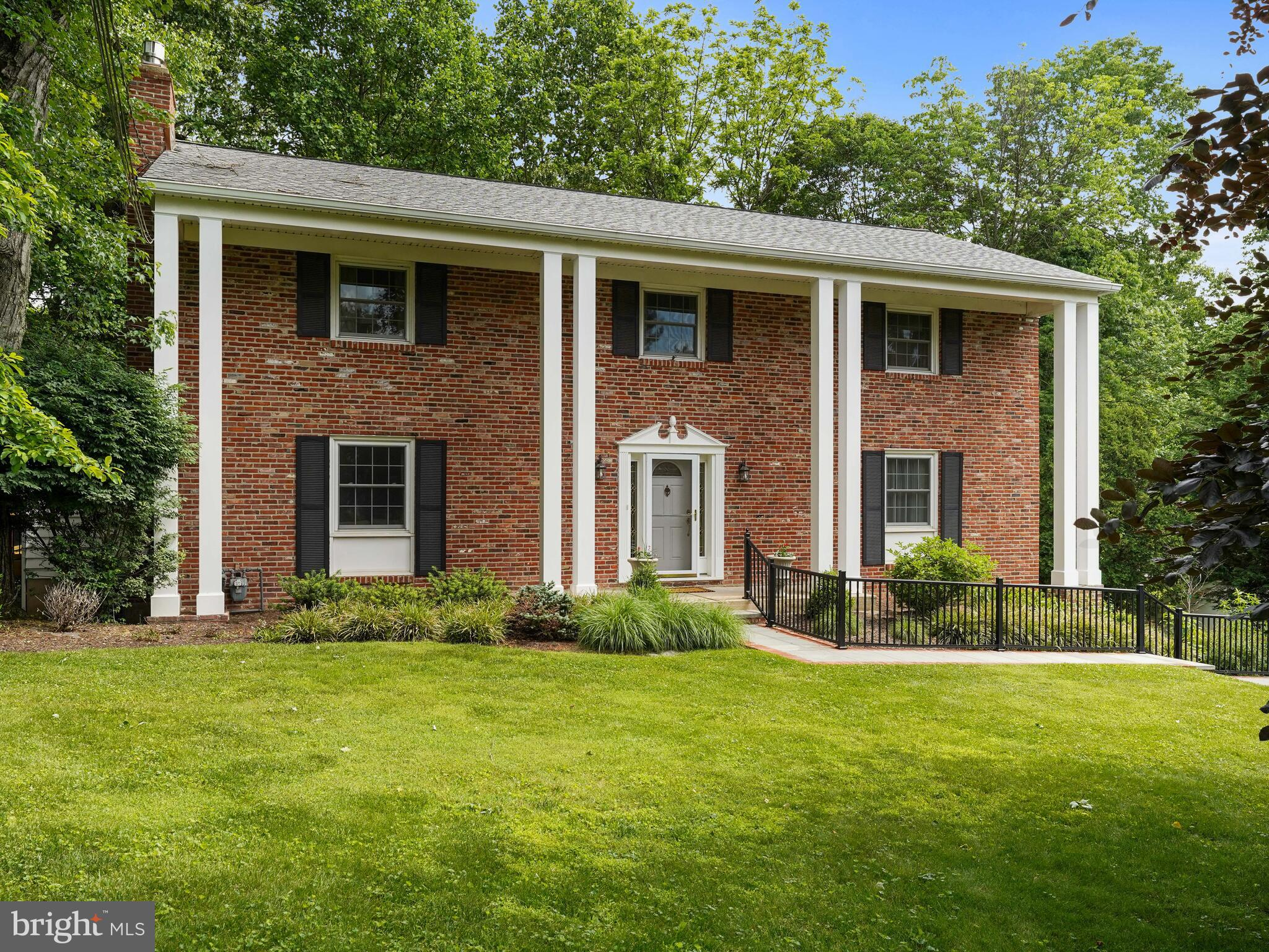 This Devon Downs Brick colonial is unique for the neighborhood. It has been remodeled and very well maintained. Newer Kitchen and baths and fresh paint allow you to move in and unpack. The family room features a fireplace with built-ins on either side and a pass-thru to the kitchen. There are hardwoods throughout the house. The main level flows well from the Gracious Foyer to the large living room into dining room and then into the kitchen and family room further flowing back into the two-story foyer. This home has a full finished walk-out lower level adding great living space. This is a unique feature for this neighborhood. The recently rebuilt wrap-around deck overlooks the woods full of wildlife.  .  The owner loves the privacy from the wrap-around deck which was recently rebuilt. It is located in the award-winning Tredyffrin/Easttown school district. Minutes from the R-5 train line and Berwyn shopping district