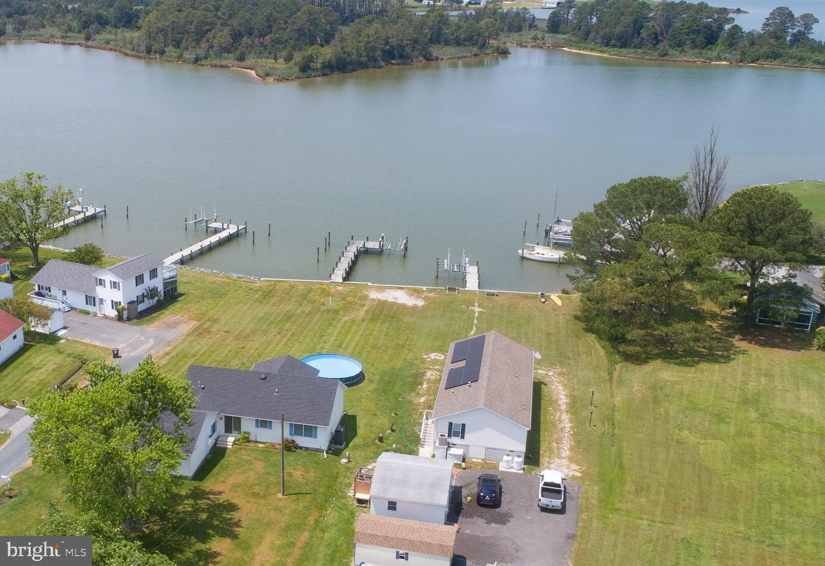 Spectacular sunsets!  This is a great opportunity to take advantage of all  the Eastern Shore offers - enjoy the views from the large screened porch, swim in the above ground pool, and crab, fish and boat from the dock. Neat as a pin 3 bedroom, 2 bath rancher with attached garage.