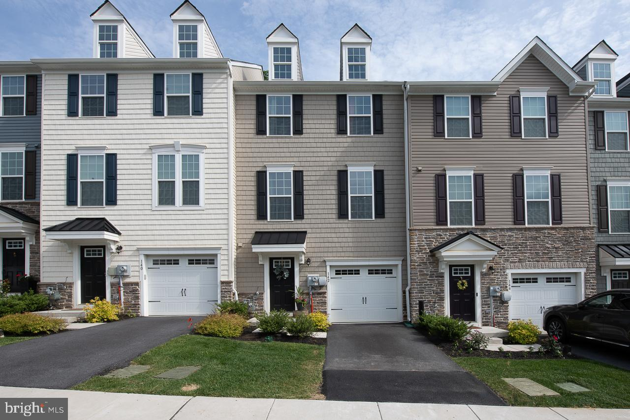"""Better than new! Unique opportunity to own this gorgeous 3-year young townhome showcasing over 2,300 sq ft of fabulous living space featuring 3 Bedrooms, 2 full Baths and 1 half Bath in this sought after """"Malvern Walk"""" location just minutes from Malvern, West Chester and Exton. 1st Level features hardwood Entry Foyer, Powder Room and 1-car garage plus large finished Family Room/Playroom w/sliders to rear yard, also ideal as Office or Exercise Room. Hardwood staircase leads to Main Level featuring upgraded hardwood flooring, Gourmet Kitchen w/hardwood, center island, granite countertops, tile backsplash, GE stainless appliances and sliders to large rear deck with private views. Kitchen opens to spacious Great Room w/recessed lighting. Upper Level features large Master Suite w/tray ceiling, walk-in closet and luxury Master Bath featuring double granite vanity, ceramic tile floor and tiled stall shower; 2 add'l Family Bedrooms, Hall Bath w/ceramic tile floor & tiled tub/shower plus convenient 2nd floor Laundry completes this level. Don't miss this fabulous move-in ready home in award winning Great Valley School District conveniently located to PA Turnpike slip ramp, Great Valley Corporate Center, KOP, public transportation, shopping & restaurants."""