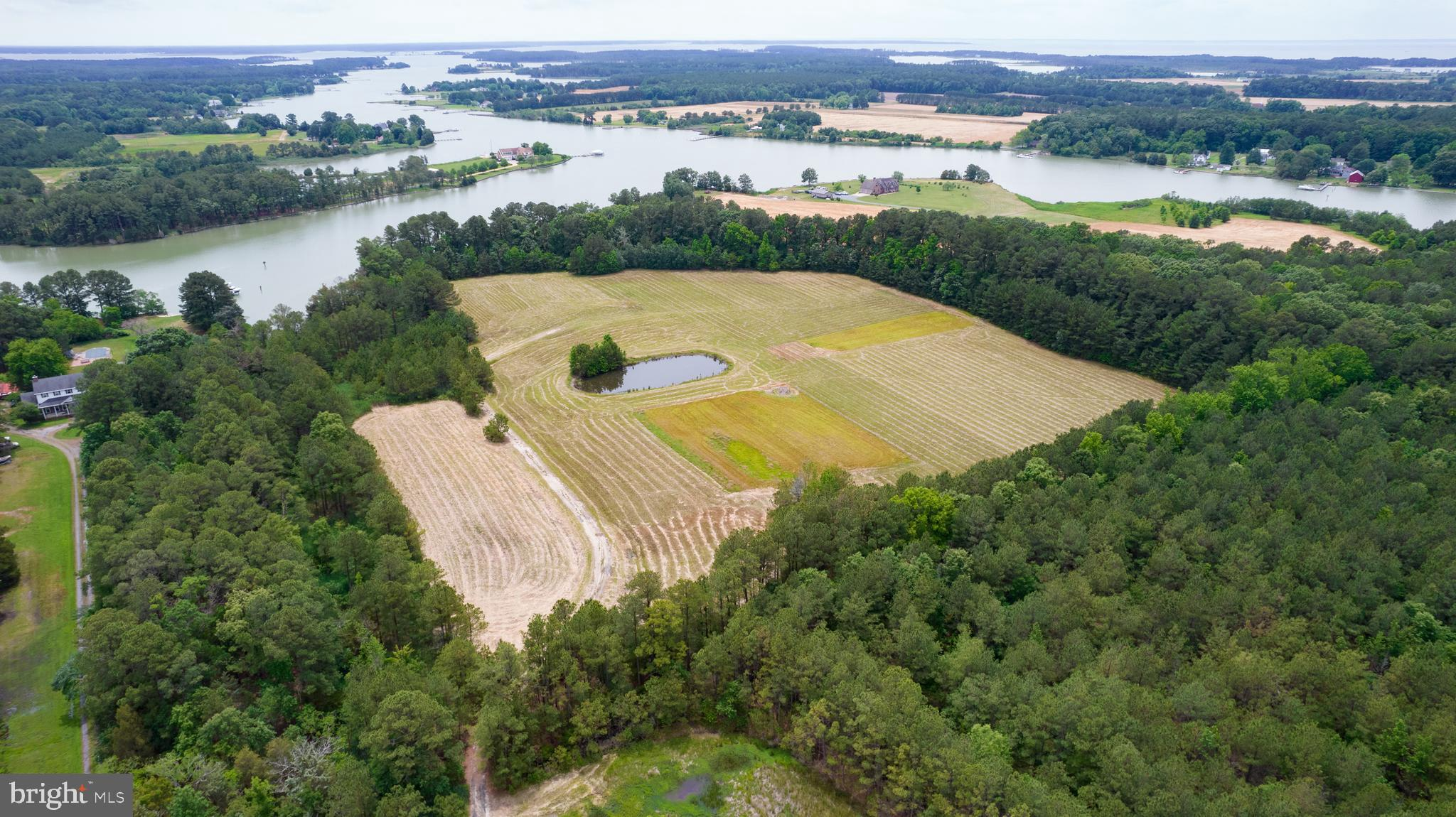 """Once known as """"Gold Dust Farm"""" this 25 acre +/- waterfront parcel traces back to a patent issued in 1669!  The perfect hunting paradise, or place to build your dream home (or both)  - this parcel is partially wooded, but also offers cleared land, and income from CRP.    The berm pond and driveway are already in place.  Located on tranquil  Hudson Creek. Well documented history  on file, and a cool back story- if you've been looking for a place on the Shore - make sure you check this one out! Quick trip to Cambridge eateries and attractions. No sign on property - gated locked entrance - appt. required."""