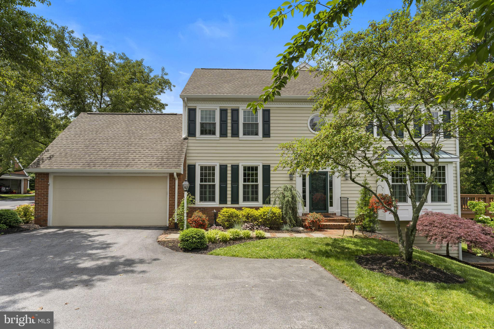 *Showings to begin on Tuesday 6/8* Welcome to 133 Carters Grove! This beautiful end-unit in desirable Tidewater has been lovingly maintained and updated by the current owners. Enter into the two-story foyer and notice the warm hardwood floors extending throughout the first floor. On your right is the formal living room with crown molding and plantation shutters, centered around the double-sided gas fireplace with a beautiful mantlepiece. On your left is the formal dining room with crown molding, chair rail and access to the kitchen for easy entertaining. As you make your way to the back of the house, you're greeted by the inviting family room with access to the double-sided gas fireplace that has an elegant stone hearth and wood mantle. The private deck overlooking community open space and Malvern Memorial Park is accessible via sliding glass doors. Adjacent to the family room is the eat-in kitchen with stainless appliances -including a conduction cooktop – island workspace with seating for four or more, granite countertops, tile backsplash and under cabinet lighting. There are two pantries for ample storage plus a pass through to the den to create an open, airy feeling. The eating area looks out over the front paver patio that's accessible via another sliding glass door. The two-car garage is also accessible for easy in and out with groceries and packages. Above the garage there is attic storage that can be accessed by pull down stairs. There is also an updated half bathroom off of the foyer. Upstairs, you'll find the lovely master suite. Through the double doors is a spacious bedroom with plenty of room for a king bed plus a sitting area. There is crown molding, ceiling fan and room darkening curtains. There are two walk-in closets each with a custom organizer system. The private master bath is beautifully updated in soft grays and whites with herringbone tile floors, a huge double vanity with a storage tower, plus linen storage and individual lighted mirrors. The