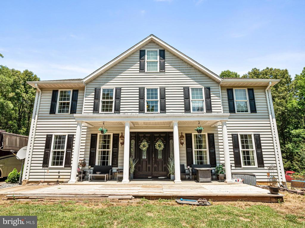 Beautiful home with many projects to make your own. Gorgeous entry with new marble flooring through the double doors. Large dining room and formal living area. Massive office space with double french door entry. Walk past the beautiful stairway to the kitchen with 42 inch cherry wood cabinets, stainless appliances, gas cooktop and lots of storage space. If you are looking for privacy this is the spot for you. The home sites on 10 acres surrounded by beautiful trees. The seller has some unfinished projects that you can make your own. Come give this beautiful home some TLC.