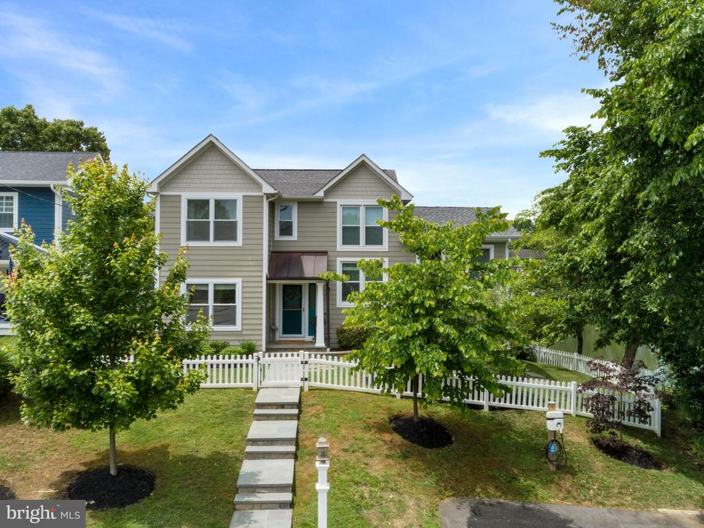 Gorgeous waterfront home with amazing sunset views, private dock, and upgrades galore! Relax in the waterfront hot tub or enjoy a Maryland style crab feast on the large deck with motorized awning. This home was completely renovated in 2016, including new hardiplank siding, lifetime architectural shingle roof, and a complete interior update. Engineered hardwood floors throughout the home. Gourmet kitchen with quartz countertops, stainless steel appliances, coastal glass backsplash, and a built in reverse osmosis drinking faucet. Custom built-in shelving frames the cozy gas fireplace.  The open concept living room / dining room / kitchen allow water views to be enjoyed from most of the first floor. A bonus room on the first floor can be used as a fifth bedroom if desired! Waterview mezzanine level bedroom suite with half bath and closet were added on in 2019 (currently being used as a home office). Wake up to water views from the spacious master suite! The second floor master bedroom includes a generous walk-in closet and master bathroom with dual vanities, heated floor, heated towel rack, and luxury tiled shower. The balcony deck off the master bedroom is perfect for enjoying gorgeous evening sunsets. Two other bedrooms with custom closets, a full bath, and laundry room with built in shelving  complete the second floor.  The outdoor entrance basement is  fully conditioned with built-in shelving for ample storage and a built-in workbench. The fully encapsulated crawl space also provides extra storage. Dual zone HVAC units (2016) allow for ultimate comfort on all levels.  Exterior updates include stone retaining walls, landscaping, bluestone paver front porch and path and a copper front entry roof.  This home borders a small cove, allowing for water views from the side of the house as well as the back. Experience nature and wildlife galore from your waterfront backyard.  Enjoy your own private dock with 18,000 lb boat lift and jet ski lift. Easy boating access to the C
