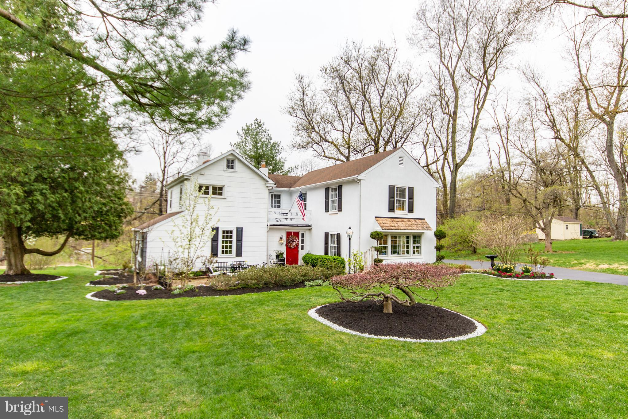 Charming and warm, updated and historic, this home is the original Gate House to the estate at the top of the hill. Owner has put her own interior design expertise on many interior details! The stunning Kitchen was remodeled in 2020 and features Quartz counters, tile back splash and newer stainless appliances. The exterior was painted in 2020, new flooring added in Kitchen and Living Room, electric panel updated, and so many other aspects of the home have been beautifully renovated. The Entry Foyer features reclaimed brick flooring from the 1700's from the Philadelphia Navy Yard. The owners discovered and left exposed 300 year old beams in the Family Room after removing an old horsehair and plaster ceiling! The Family Room features a Gas Fireplace with brick hearth and stone mantle, original Gate House windows and a pie stairway to the second level. The Living Room/Dining Room space is large and bright. There's a first-floor Powder Room, a Side Porch currently used as an office and a Bonus Room off the Kitchen that provides great storage. Upstairs are four good-size Bedrooms and two renovated full Bathrooms, one with a stall shower, the other with a tub/shower. The basement is partially finished and houses the Laundry and plenty of storage.  More storage is available in the walk-up attic. Great curb appeal as home is well set back from the street and has a generous front yard. Easy access to Paoli and Daylesford Trains, major roadways and top-ranked Tredyffrin-Easttown Schools.  Low taxes too!