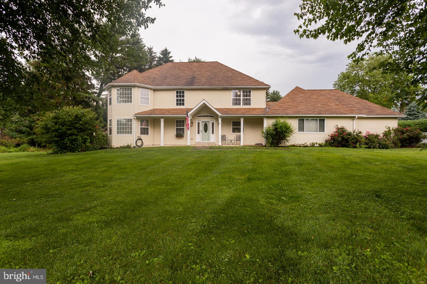 Don't miss the opportunity to own this unique colonial home in the desirable Westtown Township! This two story home is situated on over an acre and comes complete with beautiful landscaping, a 3 car garage, ample parking space, an open concept floor plan and extensive modern features. As you enter the home you are met with gleaming hand-scraped hickory floors that expand throughout the entire open foyer, the massive sunken living room with bay window & eat -in dining room.  Just inside the entryway you have the private first floor office space with double french doors, built in shelving & a large closet.  Stepping into your kitchen you have all stainless steel appliances, gas cooking & a massive center island with ample seating and brick accents & rustic lighting above. The brick fireplace with barn beam mantel is the focal point of the kitchen. The built in refrigerator & freezer allow for additional space for your entertaining needs along with the built in bar shelving and walk in pantry. Just off the kitchen is your mudroom & half bath for you & your guests convenience.  Moving up the open staircase to the second floor the hand-scraped hickory floors continue.  On this level you will find the large master suite with a bay window & double french doors onto your private deck. The additional set of french doors lead you into your master bathroom oasis with a large doorless walk in tile shower, raised tub, walk in closet & crown molding with lighting. Rounding out this level you will find 3 additional generously sized bedrooms all with ceiling fans, a hall bathroom centrally located and the laundry room.  The unique hall bathroom features 3 floating sinks & a subway tile shower. The third floor bonus loft is ready for your imagination to soar and to be turned into a space of your own with its own rooftop deck overlooking the yard and a fireplace.   As if the main portion of the home didn't wow you enough the finished basement offers a bedroom, kitchenette, living roo