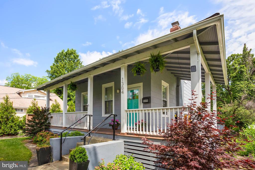 Old world charm meets contemporary living in this recently renovated bungalow in the heart of Brookland. Perched on a hill, this gorgeous craftsman style bungalow immediately welcomes you with a covered wrap around porch perfect for early morning coffee or lazy summer evenings . Upon entering the living room, you are greeted with  working fireplace and mantle for cozy nights at home with a book or for conversation with friends and family. The dining room is spacious and sunny with southern exposure and opens directly into a modern kitchen replete with carrara marble counters, under mount sink,  42' cabinets, SS appliances, and ample lower drawers for extra storage. The marble counter wraps around to an island and opens into the second living space great for chatting with friends while cooking dinner or for kids to do homework on a busy weekday night.  The open concept living room off of the kitchen leads out to the deck from a sliding glass door with large transom providing a full view of the enormous back yard. The deck is large with built-in seating for fun family gathering or grilling out with friends. The yard has an amazing play equipment area for kids and it is also perfect for planting that summer garden or a new flower garden! There is even room for a trampoline or pool! It is large enough to fit whatever your vision is.  There is also a shed in the back yard for law equipment storage as well. Heading back inside is a large and sunny bedroom on the main level with closet, hardwood floors and recessed lights. Upstairs you will find two bedrooms with hardwood floors and large closets and a beautiful full bath with marble counters and more extra storage. The lower level has a 4th bedroom and full bath and yet another living room area for tv watching, game night or for guests to relax. There is also a full size front loader washer/dryer, laundry room and an extra full size refrigerator,  more shelving and storage. This one of a kind bungalow is the complete pack