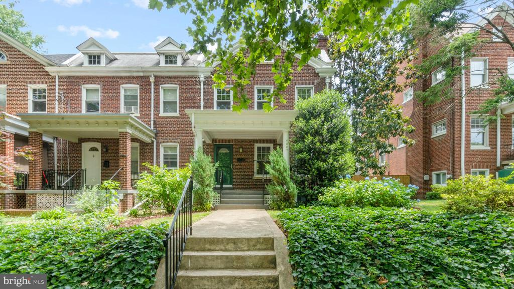 Welcome home to this charming semi-detached, 3br/2ba row-house in beautiful Brookland! Enjoy hardwood floors, a brick fireplace, enclosed back porches on two levels. Design-ready basement makes for the perfect home theater or rec room. Fenced-in backyard includes a 1-car garage and extra off-street parking. PLUS: Walk to the Metro and all the greatest hits along the 12th Street corridor, including Brookland's Finest and Yes! Organic Market. Come see this exceptional property for yourself!