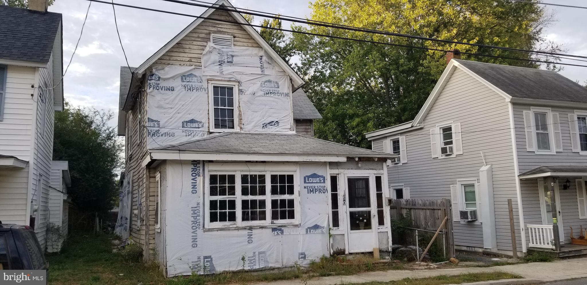 Investor Alert !  Bring an offer for this project gutted to the studs, with public water and sewer.  If you have the skills possibilities exist! CASH Only!