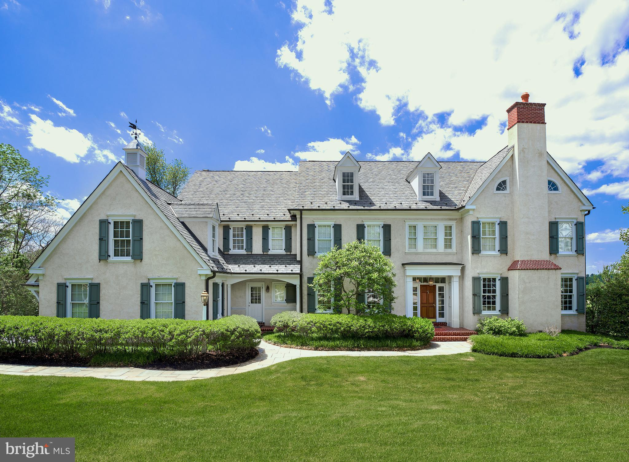 Live at the end of a beautiful, private cul-de-sac with long vistas of 100-acre East Goshen Park & Applebrook Golf Course, neither of which can ever be built on, making it feel like you are nestled on 200 acres! This elegant 2-story colonial in the most amazing location of the Radnor Hunt area affords you & your family the seclusion, vistas, and transitional-style living quarters you desire, in a premier location convenient to all amenities. Picturesque grounds surround the home and offer generous lawn for playtime & activities. A lovely open front porch and expansive rear patio provide a peaceful setting for outdoor pleasure and a backdrop for summertime entertaining.  The house has been finely updated and boasts a gracious layout that works well for a small or large family living. It is easily expandable with an optional 5th bedroom, now an upstairs storage area over the garage but accessed from the 2nd floor, plus an extremely spacious basement that has 9' ceilings & a finished bannister at the landing. The entire main floor has been completely and tastefully redone, enriched by gorgeous finishes & rich cherry wood floors, plus there is so much else to appreciate like a top-of-the-line kitchen, premium appliances & fixtures, custom closets & pantry, new AC and heating, a newer water heater and more.  An airy light-filled entry foyer welcomes you inside, presenting exquisite millwork, moldings & architectural details, with a floor-through view of French doors to the rear oasis. Flanking the foyer is a gracious living room with fireplace & gracious formal dining room for hosting in style. The top-of-the-line kitchen is a dream for the cook featuring stainless steel Thermador & Sub-Zero appliances, a built-in Miele coffeemaker, Calcutta Gold Marble countertops (also in the butlers pantry), dual sinks, instant hot & Insinkerator. Enjoy coffee & snacks in the open vaulted breakfast room enveloped by windows, or step out glass doors to the flagstone patio with a pergol
