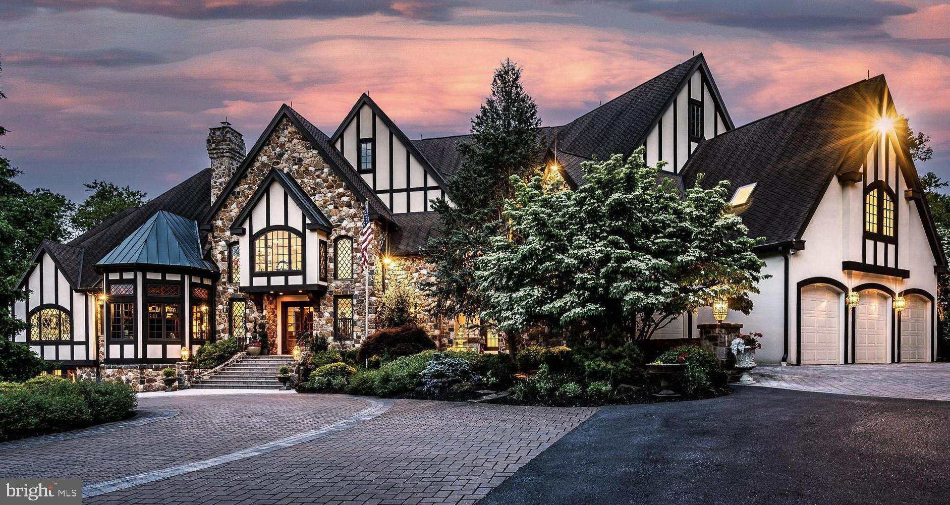 One of the most remarkable private executive estates in the Delaware Valley, this exquisite 18,000+/- square foot, 6 bed 11+ bath Tudor manor home estate on over 7 acres in Unionville-Chadds Ford School District, is now available. With secured privacy and hand crafted luxury throughout, the property has been updated by the present owners to the highest standard. A breathtaking foyer welcomes you to the grand formal Living Room with dramatic fireplace and custom cabinetry. The soaring vaulted ceilings with floor to ceiling windows showcase private views of the manicured grounds. There is a stunning masterpiece Kitchen and Butler Pantry with an additional Chef's Kitchen. The Master Suite with his/her separate baths and Walk-in Closets, and stunning Study is an oasis within an oasis. The fully finished Lower Level provides 6,000+/- square feet of living space and is replete with entertainment areas, a Game Room, two Exercise Rooms, Sauna/Steam Rooms, Wine Cellar and amazing 12 person Home Theater. The Upper Level offers four bedroom suites and a fully equipped guest suite. There is an elevator and multiple staircases to easily move between all floors. In addition to the main home, two ancillary buildings occupy the grounds: a 3-room Office Studio and a Pool House with small kitchen, bath and more. These additional spaces lend themselves to offering a family compound or they would be ideal for conducting your business from home. For the car enthusiast, there are four attached and a further seven detached garage spaces offering eleven garage spaces in total! The gorgeous Sylvan free form pool is the center of spa-like exterior spaces for entertaining and relaxing with family and friends and are superior to those found at five star resorts. This unsurpassed property is conveniently located with easy access to West Chester, the Main Line, Philadelphia, and Wilmington.