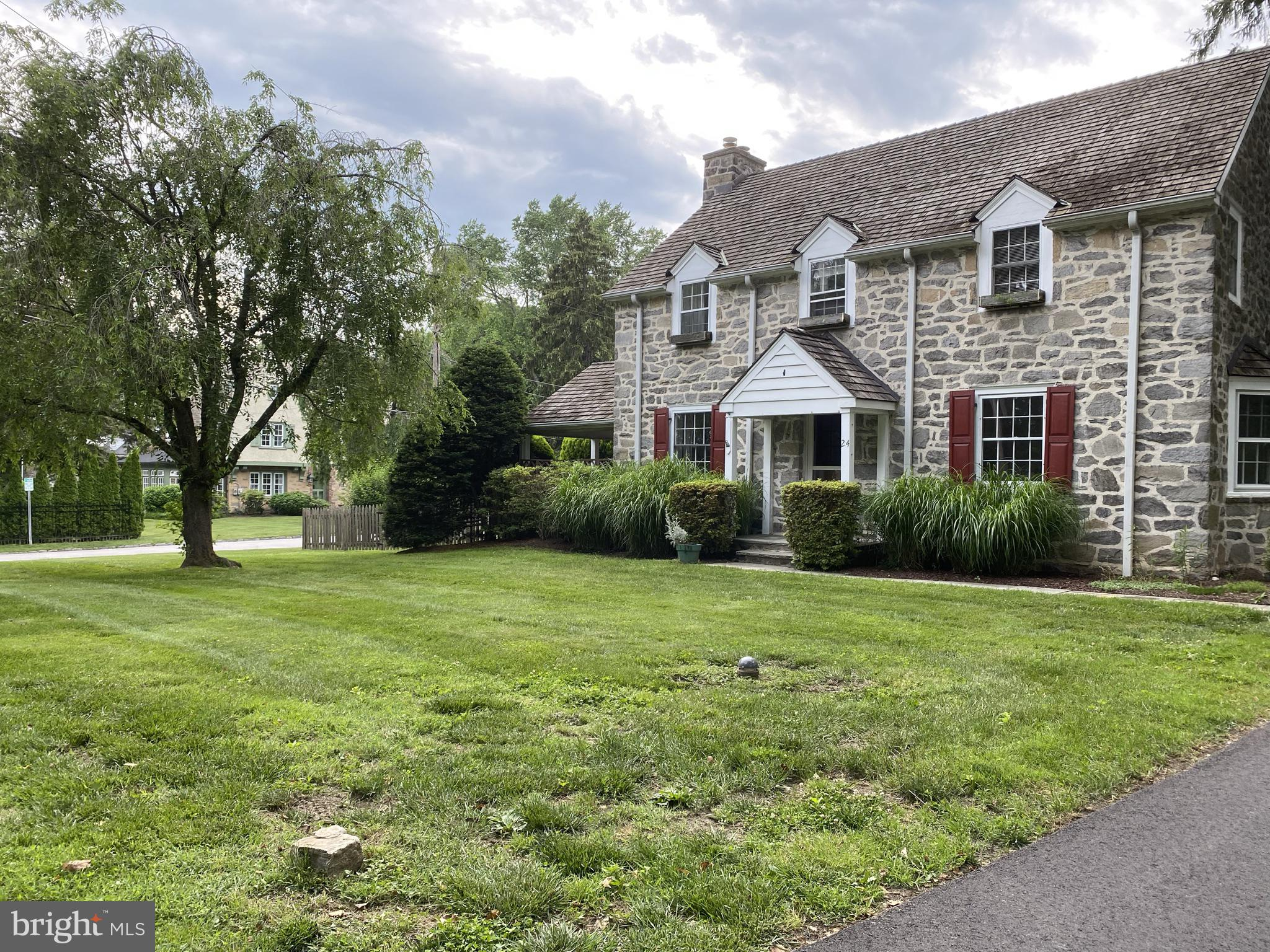 Center Hall Stone Colonial. Large Flat Corner Lot (.47 acres) with Fenced Side Yard.  Award-Winning Lower Merion Schools. Walkability within 1 mile: Transportation (NHSL, Paoli/Thorndale - Rosemont & Bryn Mawr, Bus), Universities (Villanova University, Rosemont College, Bryn Mawr College), Parks (Harriton, Ashbridge, Austin Memorial, Unkefer, Emlen Tunnel, Clem Macrone) Bryn Mawr Hospital, Dining, Coffee, Shopping, Grocery. Minutes to 476. This home emotes quality and charm. Large living room with wood burning fireplace, custom built-ins, and access to a side covered porch with mature landscaping to provide privacy. Dining room with crown molding and large bay window providing lots of light. Kitchen features stainless steel appliances, hardwood floors, breakfast nook and backyard/driveway access. 2nd Floor includes 4 Generous Bedrooms and 3 Full Baths! Main Bedroom has En-Suite and access to 3rd Floor Bonus Room.  Large Basement with Natural Light, Exposed Beams, 1/2 bath, Laundry Area and Ample Storage! Note, many homeowners of this style kitchen have removed the kitchen/dining room wall and made a lovely, large new area. Also consider all of the property where one could expand if so desired.