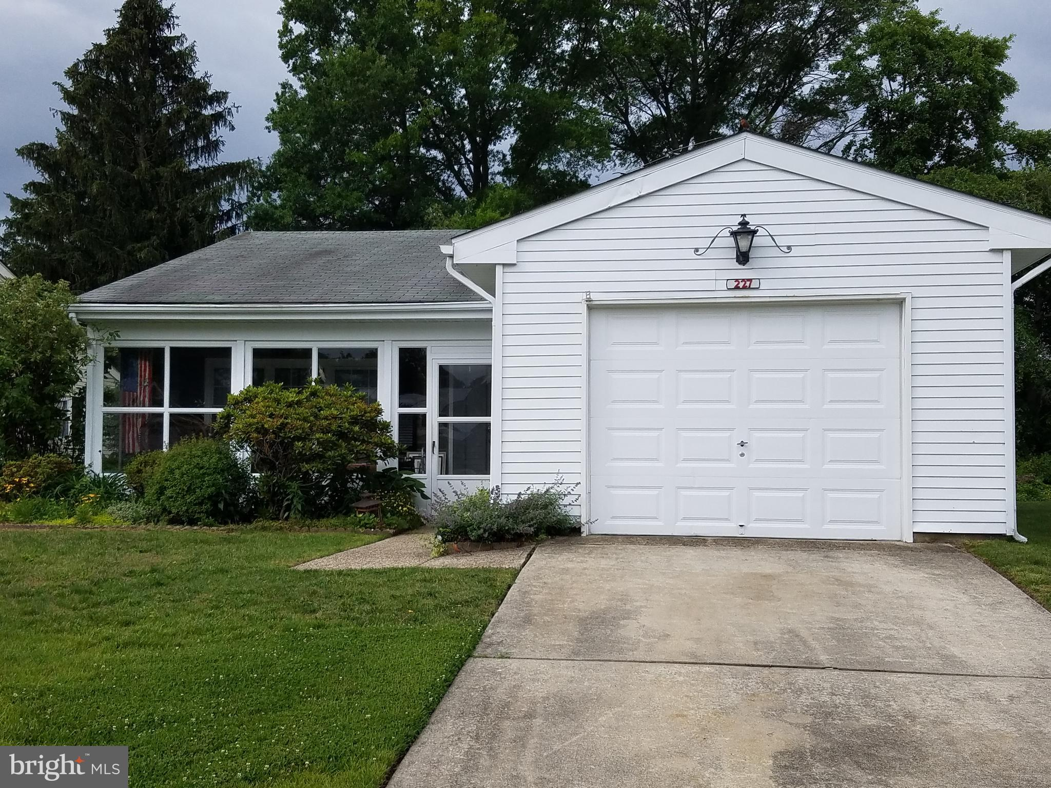 Welcome to this popular Gladwyne model. 2 Bedroom, 1 1/2 Bathroom with Sun room/den.  Enter enclosed front porch to carpeted living room and protected access to garage. Kitchen is updated with laminate flooring and cabinets. Walk thru dining area to Sun room/den . The back yard is private lined with trees and large patio. No need to use baseboard heating with upgraded heat/AC ex-changer installed in 2016. The Laurel Hall clubhouse, heated pool and lake is one block away. Very convenient. Leisuretowne has many amenities for your active life style. 2 Pools and clubhouses with libraries and meeting rooms. Lakes, tennis courts, putting green, driving range, bocce, shuffle board, bus transportation, clubs, and exercise/weight room. 24/7 security. Seller to provide at closing a HSA One year Home Warranty for your peace of mind.