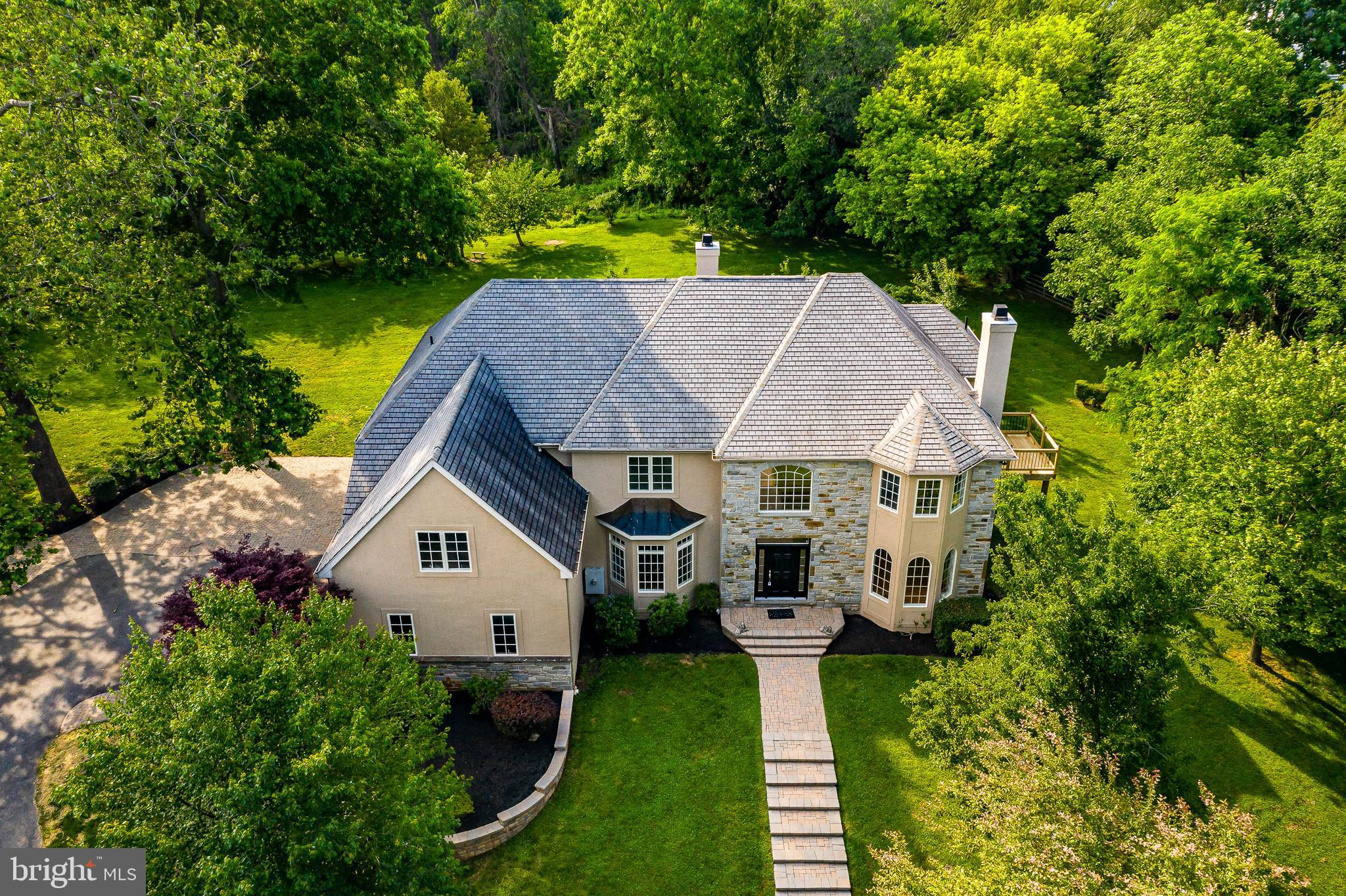 """Available for immediate settlement. Centrally located East Bradford Township Executive Single. Situated on private 1.6 acre lot with extensive hardscaping and landscaping,  level lot, perfect for entertaining and plenty of room for a pool. Outside entertainment paver patios, three car attached garage (one of the garage spaces lost 1/2 it's space to an interior room constructed). This is a front to back 2 story Colonial extensive tile flooring, site finished hardwood floors and high-hat lighting throughout. Grand 2 story entry foyer with pillars. Main floor includes living room with fireplace, large formal dining room, family room with stone fireplace off the kitchen, den/office, unique butler pantry with additional dishwasher, wine rack and stainless steel refrigerator, 42""""  kitchen cabinetry, includes island, granite countertops, stainless steel appliances, adjoining breakfast room, extensive windows offers natural light, French door leads to outside entertainment area, mud room, 2 conveniently located half baths, additional main floor room could be used for numerous ways and is currently used as an additional office space includes entrance from the garage. Second floor offers 5 bedrooms , 3 full baths, to include master bed with gas fireplace, tray ceiling, private outside entertainment deck, lavish master bath. 5th bedroom includes large separate room suitable as a sitting room, gym equipment etc. Natural gas, on site septic and well. There are front and back staircases."""