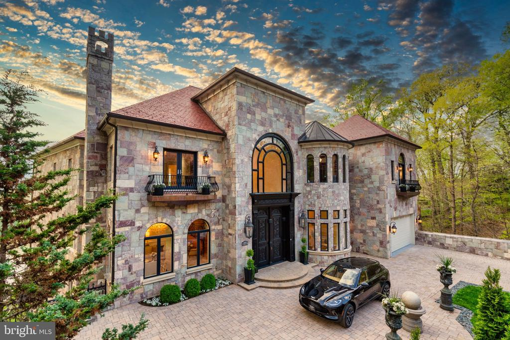 Reflecting the best of European architecture and positioned high above the banks of the Potomac River lies one of the great homes of the Capital Region, Chateau Grande Vie. Its name hailing from the unequivocally serene views it offers residents from nearly every room of the estate. The handsome turreted stone façade is set against a verdant wooded landscape on a privately sited 85 foot stretch of untouched riverfront in prestigious McLean, Virginia. The grand atrium welcomes guests with soaring cathedral ceilings anchored by a curved staircase comprised of intricate wrought-iron detailing, which serves as a functional work of art, setting the tone for the 16,000 square foot expanse. Beyond the main stair, a generous family room, river views from every window, a handsome study with an adjacent outdoor terrace and a chef's kitchen with professional-grade appliances highlight the main level which are accented by imported marble, Brazilian cherry flooring, and numerous crystal chandeliers reminiscent of the finest homes found along the French and Italian Rivera.   Ascending the main staircase first draws the eye upward — to a sculpted, barreled ceiling reflecting visions of the renowned Roman Pantheon. An owner's suite, unlike any other, offers surreal river views, complementing four additional bedroom suites, each featuring lavishly appointed marble baths with jetted jacuzzi tubs. Descending to the first lower-level reveals the ultimate entertainment space, framed by Corinthian columns and comfortably able to host a hundred or more of the most distinguished guests. The spa-level is a true showstopper, featuring an indoor pool lined with intricate mosaic tile, as one would find in the world's most luxurious resorts - the level also features a custom-crafted sauna. Five sets of imported mahogany, wrought iron, and glass double doors bring in the sights of lush greenery, feels of the river breeze, and the sounds of the national anthem being played across at the Carderock