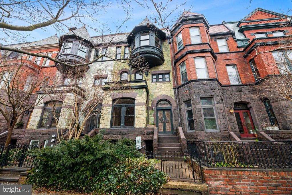 For the first time on the market in 45 years, this rare and distinctive circa 1885 T. F. Schneider-designed Brownstone is located on one of Dupont's most preserved blocks. The impressive historically significant facade welcomes you to additional coveted features inside including original heart pine flooring, high ceilings, original moldings, fireplace mantels and many more period details. Awaiting your personal touches, this nearly 4,500 square foot property has tremendous potential as a private residence or multi-unit condo project. The generous floor plan provides for spacious rooms throughout the home. The main floor living rooms and grand dining room all open up to a gated rear patio, plus parking for 2 cars. The second level features two bedrooms, including a primary bedroom suite with large bathroom and dressing room. The upper level includes three additional guest rooms and a full bath. The lower level is a separately metered one bedroom and den apartment with front and back access. This property features central air, gas heat and a tin roof. A truly special offering on one of Dupont's most coveted blocks. Sold as-is and pre-inspections are welcome. Property is zoned RA-8. OPEN BY APPOINTMENT SUNDAY 2/28.