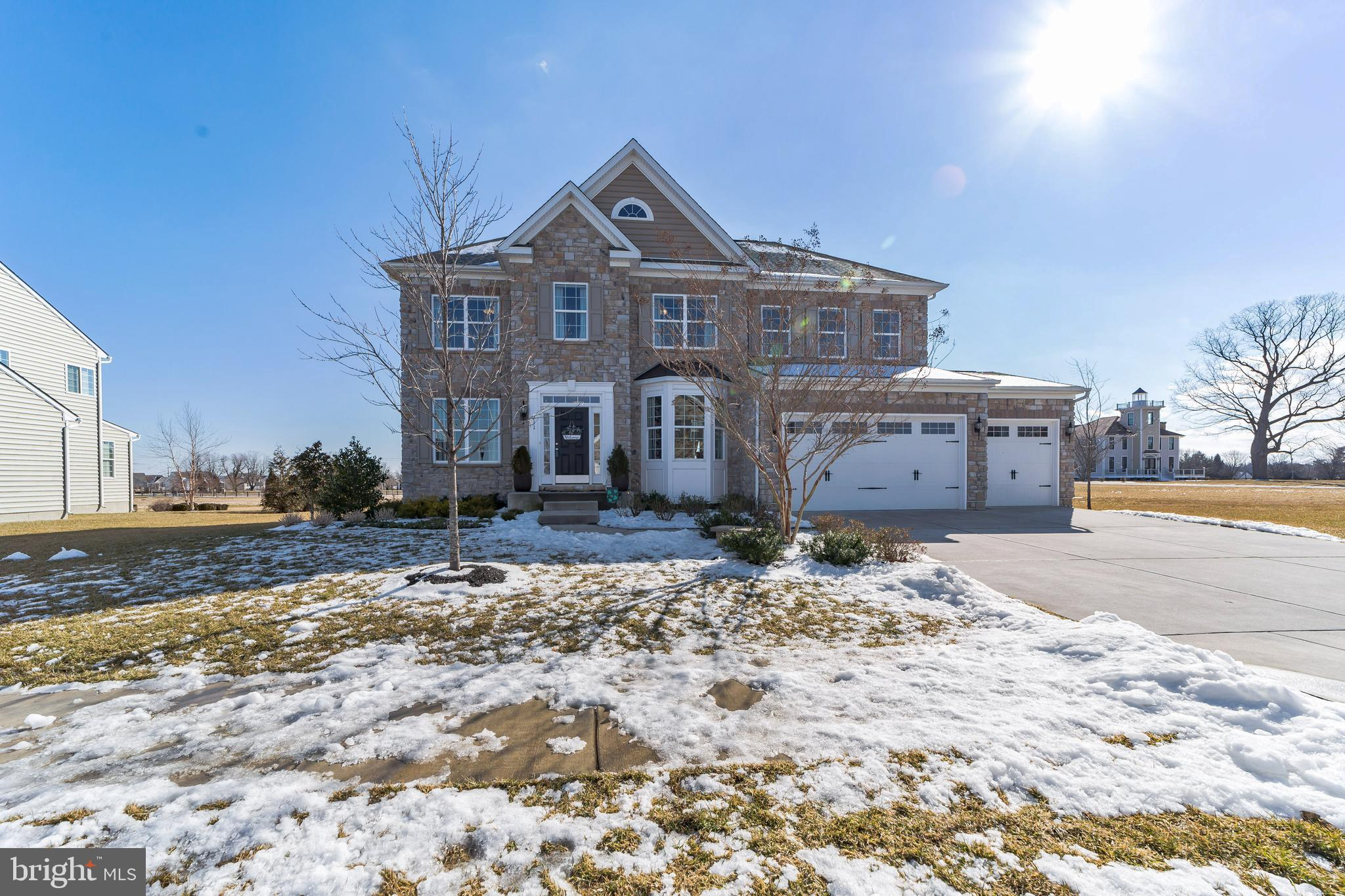 Don't miss this meticulously maintained home in the sought-after neighborhood of Ashby's Place! This community of only 54 homes is situated in the award-winning Appoquinimink School District. This lovely stone front home with a three-car garage and a walk-out finished basement impresses from the moment you pull into the driveway. Upon entering the large foyer, you are flanked by the large, open living room and dining room with wide plank hardwood floors that run throughout the main level. The foyer leads you into a grand two-story family room with a floor-to-ceiling stone fireplace. Located on one side of the family room is a large home office/den with lots of natural light. On the other side is your large eat-in kitchen with an island, stainless steel appliances and double wall ovens. The sliders lead to additional living space on the paver patio with garden walls. Upstairs the main bedroom with its walk-in closet and large tile bath is the perfect retreat. Also on this level are three large bedrooms, two with walk-in closets; the second full bath and your laundry area. The walk-out basement is finished with lots of extra living space, storage and another full bathroom! Be sure to put this on your tour today!
