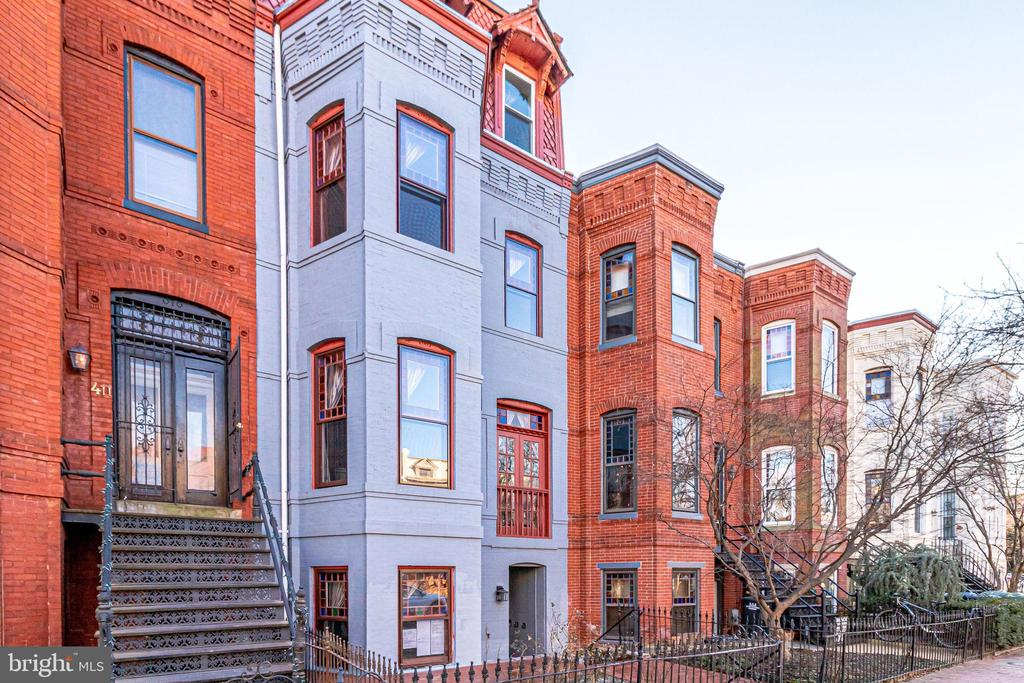 Located in the heart of Capitol Hill's Historic District, this home offers everything a new or seasoned investor could possibly need. Current CoO for 4 units, perfect for financing with a residential conventional loan. Fully refurbished, separately metered for each unit on its own floor. Within walking distance are the Capitol, Supreme Court, Union Station, parks, and various amenities. Over the past year this property has been fully modernized, while the historic charm that makes this building so appealing has been meticulously preserved. Along with electrical heavy up, brand new roof, brand new appliances with in-unit washer/dryer, and fully updated finishes, each unit features its own brand new kitchen and brand new bathroom. A brand new immaculate custom built staircase connects the four units inside with an updated rear patio that is sure to connect everyone outside. Three of the four levels are 2 bedroom, 1 bath units allowing for versatile living arrangements that appeal to a wide variety of potential tenants. The 1 bedroom, 1 bath unit on the first floor makes this a dynamic property that you could live in or rent out for even more positive cash flow! The front door features a digital lock keypad making access for showings and handymen a breeze, while providing the peace of mind that the property and your tenants are secure with security cameras throughout the common areas. In addition, each unit has its own private wifi password for improved network security. 409 Constitution is a north-facing building that allows for optimal sun exposure that occupants can enjoy on their back porch, or in their living rooms through the large bay windows. Not only does each unit have high ceilings, traditional baseboards, and newly installed recessed lighting giving every space a commanding feel, but every unit also has its own working fireplace adding to the cozy charm found throughout the entire property. Additionally, all furnishings are included in the sales price. Whatever the need, whatever the circumstance, this is a highly adaptable and unique property that you are not going to want to miss!