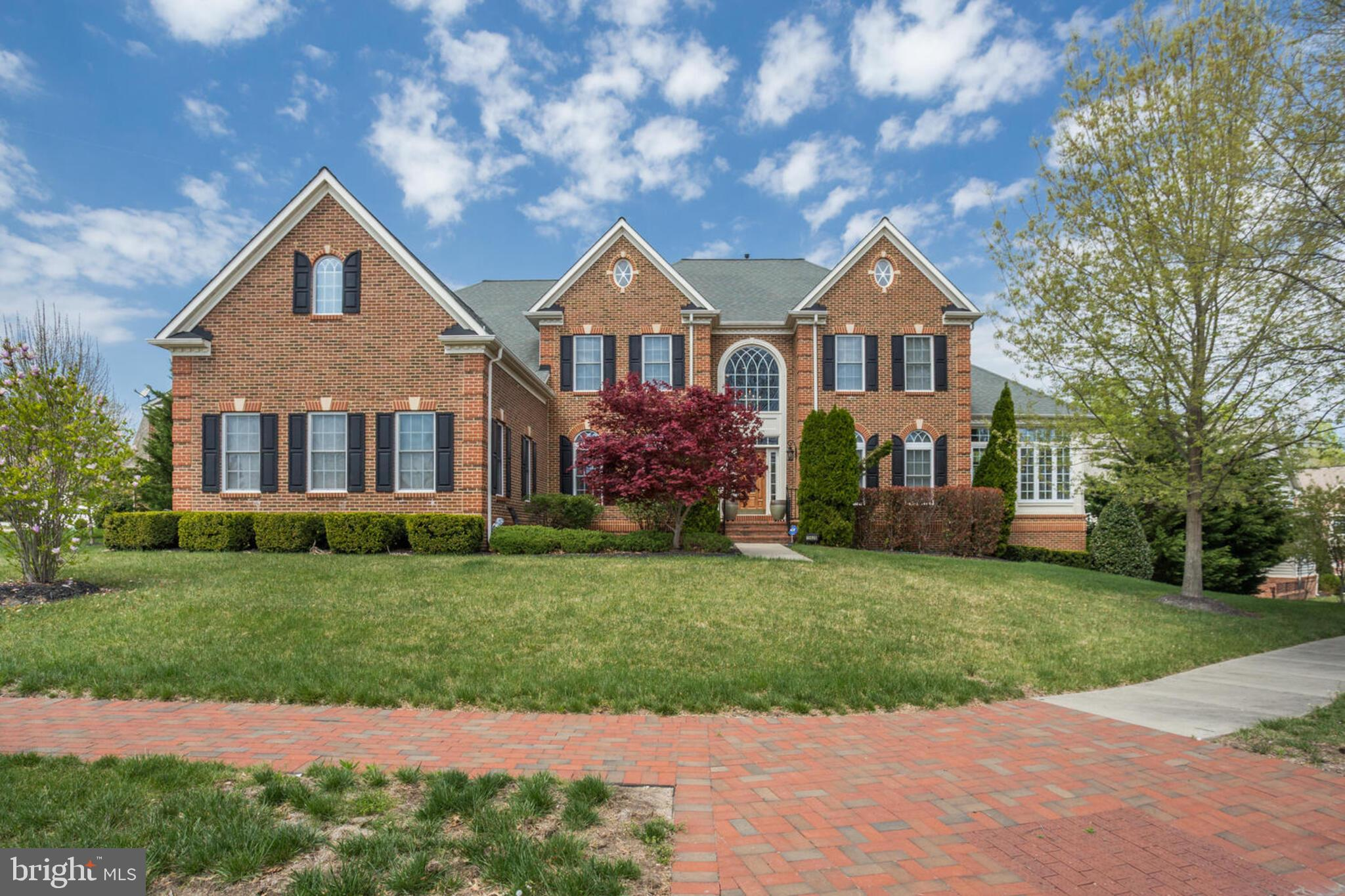 The glamourous Clifton Park model by NV Homes.  This large, stately Colonial sits on a desirable corner lot in the amenity loaded BeechTree community.  Floorplan designed with convenience in mind.  Grand two story foyer accented be a beautiful dual staircase.  Formal dining room and living room separated by graceful columns.  Stunning, light flooded conservatory with tray ceiling.  Two story family room with with gas fireplace, granite hearth and built in bookshelves.  The gourmet kitchen is a chefs paradise with a huge island, double wall oven and pantry.  Morning room with French door exit to deck.   Study, powder room and laundry also on main level.  Four bedrooms and four baths on upper level.  Luxury owner suite with sitting room, ceiling fan, 30 ft. walk in closet, and attached spa bath featuring gorgeous tile work, jetted tub, separate shower, built in wine chiller and dual vanity.  Fully finished basement complete with home theater, rec room with gas fireplace, workout room, full entertainment kitchen, one bedroom, one full bathroom and private exit.  Three zone HVAC.  Lawn irrigation system.  Truly a grand residence.  Resort style community features a recreation center, swimming pool, tennis courts, fitness center and more.   Enjoy over three miles of walking trails.  Award winning 18 hole Championship Golf Course winds through the community.  A waterfront restaurant is located in the Lake Presidential Clubhouse.  Must see!