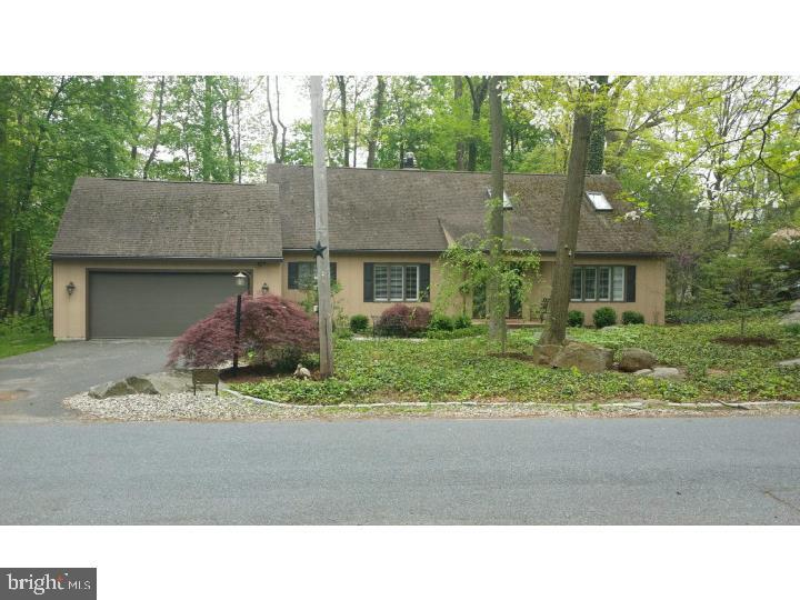 Fabulous Cape in exclusive Rockford Park neighborhood, near Art Museum. Serene wooded setting with naturalized landscaping. This home features first floor master bedroom suite, four seasons room , embossed copper ceilings in kitchen and family room. Slate floored entry and beautiful random width hardwood floors throughout the downstairs enhance the upscale, relaxed feeling of this exceptional home.  Upstairs office is a lovely room which could easily be used as 4th bedroom as it has a closet adjacent to entry door. Enjoy outdoor entertaining on large Trex deck