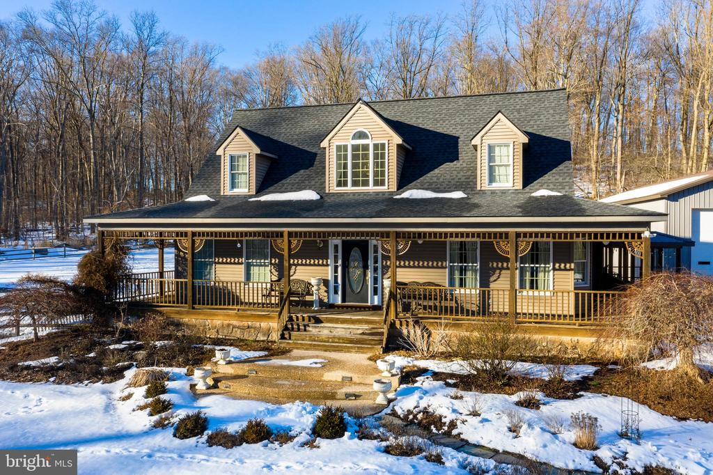 ***ALL OFFERS TO BE SENT TO LISTING AGENT BY TUESDAY MARCH 2nd at 7PM.**  SELLER WILL RESPOND ON WEDNESDAY MARCH 3rd.  Welcome to 79 New Road in the Bucolic Township of West Nantmeal!! This SPECIAL Property is situated on 4 acres with a meandering stream, surrounded by trees and the opportunity to have your pond (Owner has removed the dam). The home is a 2 Story Cape Cod w/ 3 Bedrooms and 2.1 Baths.  As you  enter the front of the home you are welcomed by a Wrap around porch which you can sit to take in the wildlife and the scenic views. The first floor boasts a Hardwood floor Entry, Powder Rm w/ tile floor, Formal DR w/ Hardwood floors and decorative moldings, The Kitchen is adjacent w/ Oak Cabinets, Dbl Sinks, NEW SS Appliances include GE Microwave (2018), Bosch D/W (2017)  4 Burner Range w/ Griddle,  8x8 tile floor and a tile backsplash,.  There is a Light and Bright Breakfast Room to enjoy your morning coffee w/ Ceramic tile floor that has radiant heat.  The Great Room has a  Stone Front Gas fireplace, Vaulted Ceiling and Radiant Heat under the Ceramic tile floor.  The Buyers will love the First Floor Bedroom w/ Ceiling fan, Ceramic tile floor and a Luxurious Master Bath w/ Jacuzzi tub, Dbl sinks, Full shower, tile floor and a Walk in closet-  You also have a back door to the First Floor Office  w/ Stamped Concrete floor that also has French Doors to the Family Room.  The Fenced in Back Yard is great for dogs and you have a large concrete patio to enjoy the Summer Barbeque's. This level also has the Laundry w/ tub and cabinets which leads to a door off the side porch.  The second floor has 2 Bedrooms and a Full Bath w/ attic access.  The lower level has a Finished rec area w/ 20x20 tile floor,  Pool Table, Gas fireplace, Dry bar and plenty of Storage for anything.  The New Buyer will relish the Pool, Pool House and Shed to have those summer get togethers.  For the RV , CAR , CONTRACTOR ENTHUSIASTS- The property has many buildings and garages to satisfy storage o