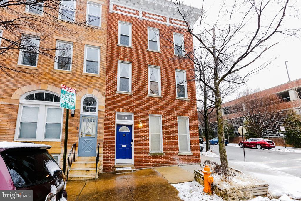 """RARE INVESTMENT OPPORTUNITY!"" This home offers you two complete units on separate meters in the continually sought after neighborhood of Washington Hill! Right between Little Italy, Upper Fells Point and Butchers Hill which is walking distance to Johns Hopkins. Enjoy the view of a beautiful park across the street for a more scenic sight in Baltimore City! Walk in to your shared foyer with newly installed tile flooring. Each Unit has its own entry to the outside as well.  The larger unit offers an open floor plan which has been recently updated so you can just move in and get cozy! The kitchen has white cabinets and that barn door you've always wanted to cover your laundry. The kitchen has been opened to your formal dining area for fabulous dinners with friends and family! Want to entertain outside? Walk out to your back yard from the dining room which features a patio space for relaxing on those cooler spring and summer nights! As you walk upstairs you will find 3 spacious bedrooms and a second full bath that was updated as well with all the newest trending features! Ceiling fans in every bedroom to help you stay energy efficient.      Lets talk about the 1 bedroom unit! This unit is complete with luxury vinyl flooring an open galley kitchen with breakfast bar, a spacious family room, its own laundry space and a walkout to its very own patio!   Parking??? No issues. This home is across the street from a quiet park so no competition from your neighbors!  It also offers side street parking and a permitted 16 space parking lot!      The homeowners have taken prestige care of this home and are ready to turn it over to you! Move In and start making money right away!"