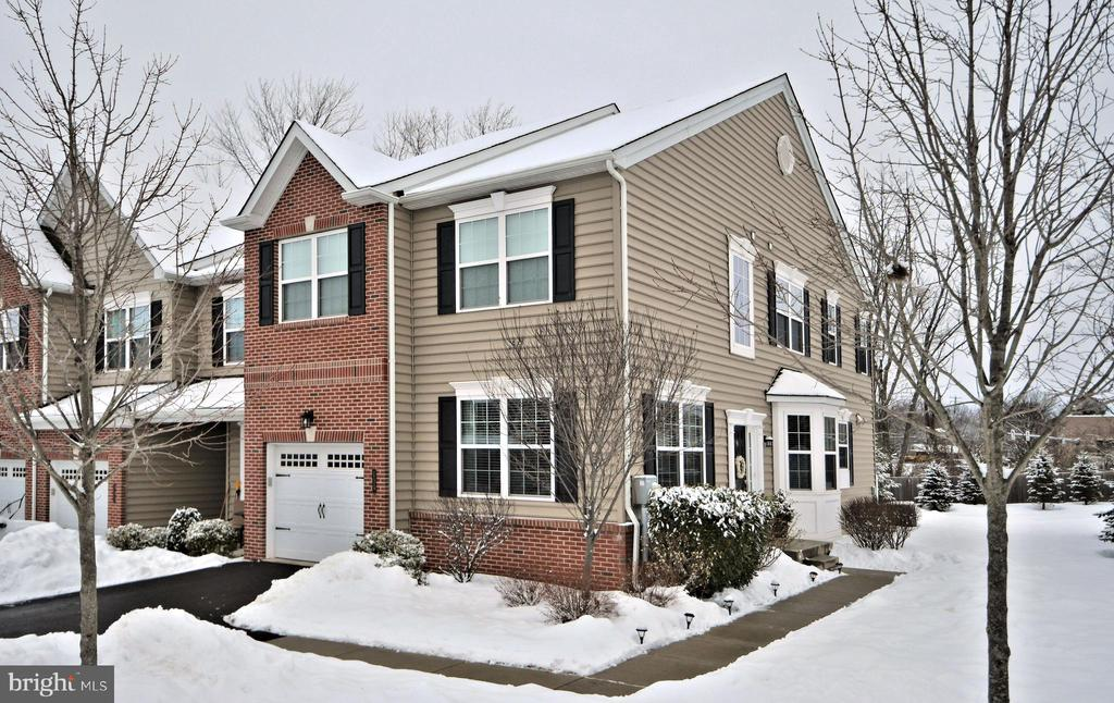 Shows like a model home!!  Only 5 years old!!  This luxury end-unit townhome features 4 bedrooms, 3.5 baths, 1 car garage and a fully finished basement with a full bath. Some of the upgraded features include an eat in kitchen with Island that allows for counter seating, granite countertops, ceramic tile back splash and stainless steel appliances.  Great room has gas fireplace and leads out to the private rear composite deck.  There is a first floor study with French doors and recessed lighting as well as a  dining room with bay window.  There are 9' ceilings on the first floor and most of the 1st floor has hardwood flooring.    The second floor boasts the main bedroom with cathedral ceiling and ceiling fan, large walk-in closet and full main bath with double bowl vanity and large stall shower with seat. There are also 3 additional bedrooms, a full hall bath and good size laundry room to round out the second floor. The full finished basement offers a full bathroom with tile flooring and a tub shower, a built in bar area and a large entertaining space.  The community offers a walking trail as well as plenty of over flow parking.  Last but not least is the location!!  Mainland Square is just minutes from the Lansdale interchange of the Pa. turnpike which makes any commute a breeze. This is a must see home!!  SHOWINGS START SATURDAY MARCH  6TH.  AGREEMENTS WILL BE PRESENTED TO SELLER ON MONDAY EVENING.  PLEASE HAVE ALL OFFERS IN BY NOON ON MONDAY.