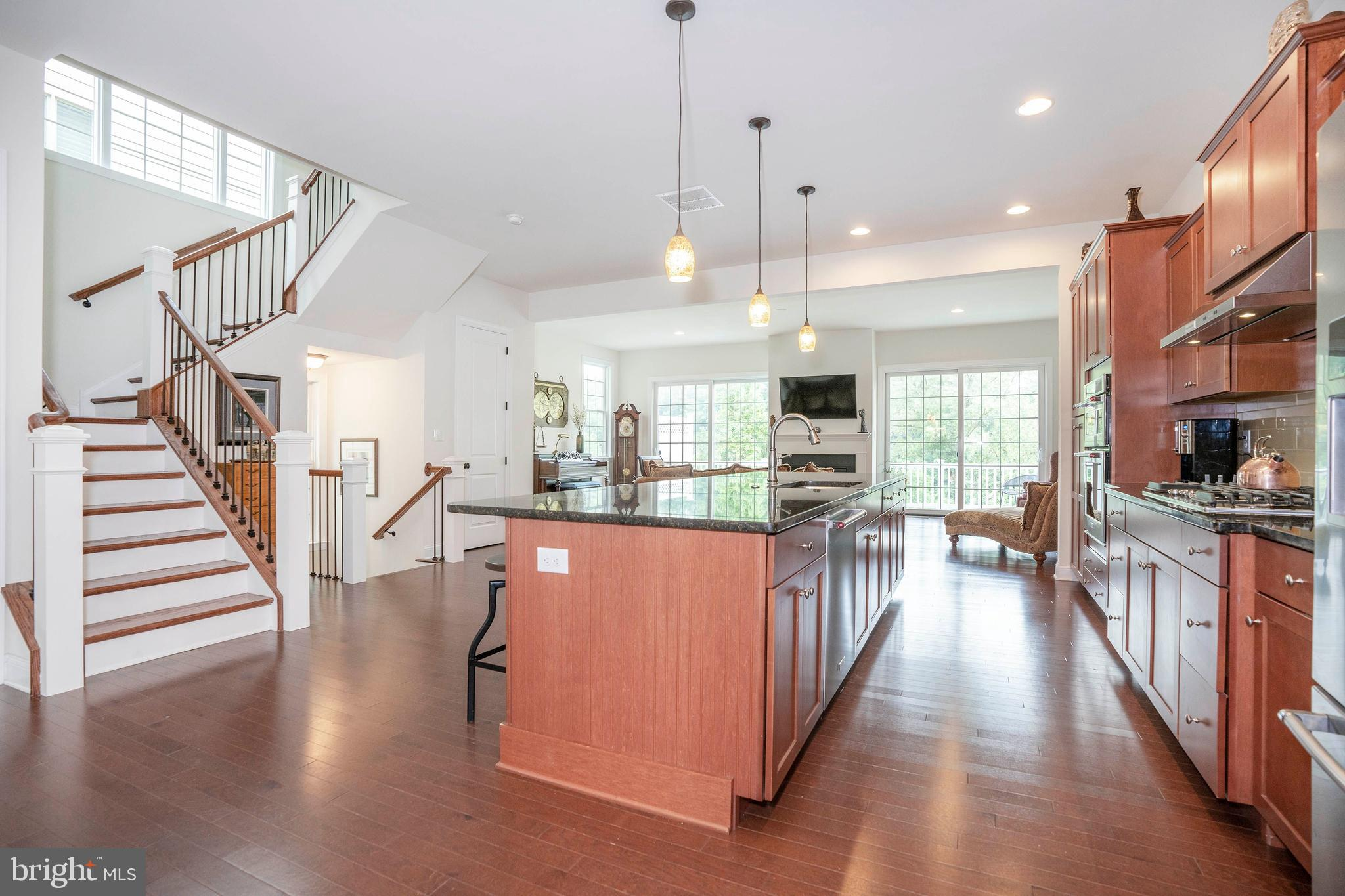 Here is your chance to own an (almost) new home in the classic and historic Highlands and Rockford Park neighborhood! Built by award-winning Montchanin Builders in 2019, this luxurious end of group townhome offers beautiful views overlooking Rockford Falls, the Brandywine River, the Alapocas Greenway and rock climbing wall! Truly an OPEN CONCEPT floor plan with loads of natural light, this home boasts 10' main floor ceilings and 9' ceilings on the entry level and upper floor. Featuring a gourmet kitchen with designer cabinetry, oversized island, counter height for entertaining and every day living. Pocket office on main level and bonus bedroom and living space on the entry level with a full bath featuring tiled floor and granite vanity top.  The unfinished basement as doors to a walk out level at the back yard and could easily be finished for bonus space including a home theater room, play room, home office, artist studio or workshop! This home features natural gas heating, high efficiency Jeld-Wen windows, concrete siding and stone which all combine for an energy efficient home. This lifestyle is truly low maintenance since all of the grass is cut, and lower beds are maintained by the association for a low monthly fee. Ideally located within walking distance to Trolley Square for shopping, restaurants, hospitals, nearby Rockford & Brandywine Parks, the Delaware Art Museum AND with easy access to all major highways.