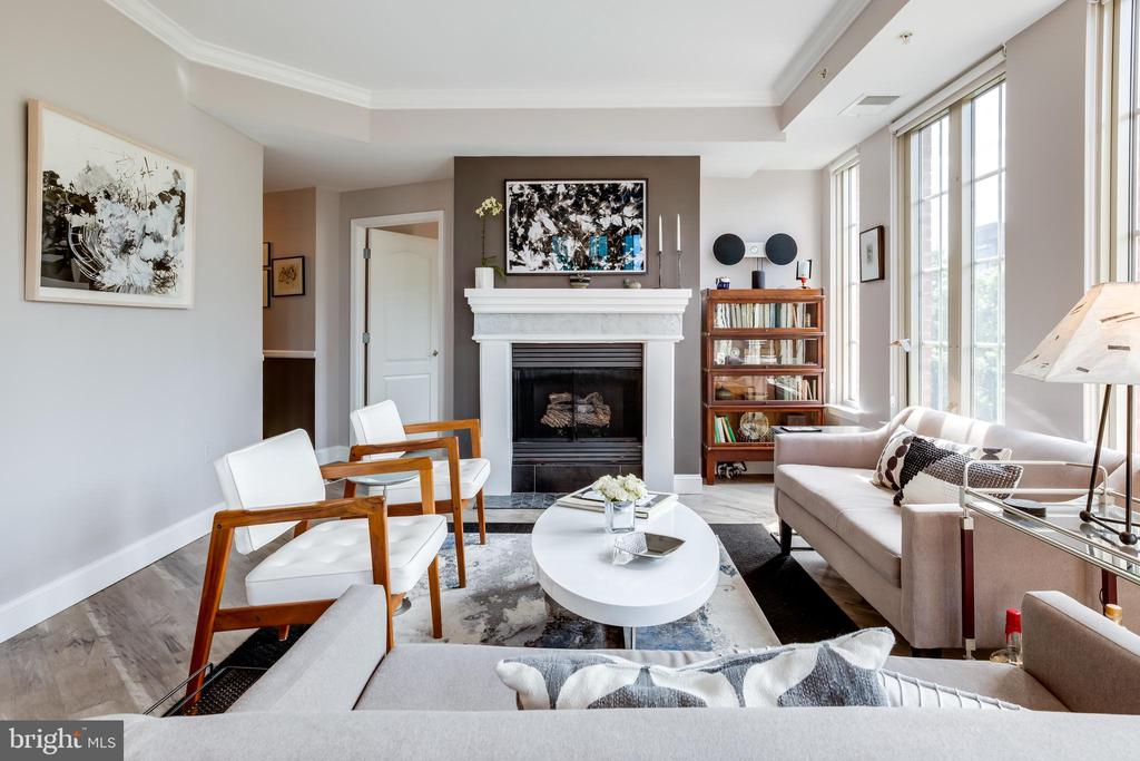 Designer 3 Bedroom in Logan Circle | 3 Bed | 2 Baths | 1,325 Sf | 1 Separately Deeded Garage Space | Building: 157 Units, Full-Time Concierge, 2 Elevators, Fitness Center, Party Room / Entertainment Center, Courtyard | Unit: Fully Renovated in 2017, Corner Unit, Wide Plank Vinyl Flooring, Designer Lighting, Walk-In Closets w/ Built-Ins, Frameless Glass Enclosed Shower, Plenty of Storage Throughout, Custom Roller Shades, Ann Sacks Tiles in Entry, Fireplace w/ Custom Mantle & Screen, Separate Living & Dining Spaces, Open Floorplan, Washer & Dryer (almost new) | Kitchen: Porcelanosa Kitchen, Miele Professional Stainless-Steel Appliances, Built-In Miele Coffee Maker, Moveable Kitchen Island w/ Storage, White Solid Surface Krion Countertops, Ceramic Tile Backsplash, White & Dark Walnut Cabinetry, Full Size Dishwasher, Gas Cooktop | Bathrooms: Vanities w/ Storage, Ann Sacks Tiling, Full Size Tub, Koehler Toilets
