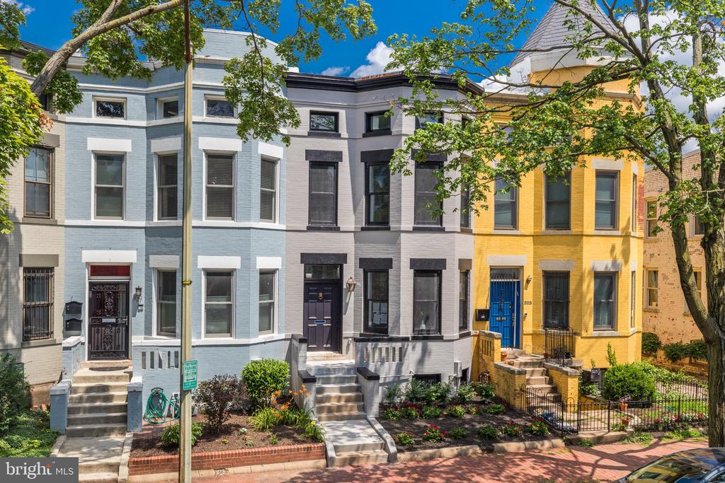 Please join us this Sunday, August 8th, for an Open House! Welcome to 325 11th Street, a luxury Capitol Hill row home fully renovated by Dogwood Restoration with the highest quality craftsmanship and finishes! This impressive 5 bedroom, 3.5 bath Victorian is located in the desirable Maury Elementary school district only three blocks from Lincoln Park and less than a mile to Eastern Market. High-end, designer details throughout include: French white oak engineered hardwood floors, Calacatta quartz counter and backsplash, top of the line appliances, custom box paneling, millwork shelves and hood vent, generous ceiling heights, exposed brick and exciting lighting. The entire interior and systems have been updated - new 2 zoned HVAC, new plumbing and all new electrical. No detail has been missed in this top to bottom restoration!  The property features almost 3,500 square feet of finished living space on 3 expansive levels. The main floor has been completely opened up for flow and function with multiple gathering spaces, a custom-designed top of the line chef's kitchen with oversized island and spacious dining room with French doors opening onto a private deck. The upper level features three generous bedrooms and two baths including the bright and spacious primary bedroom with luxuriously appointed en suite bath, custom built-in closet and convenient stackable, bedroom level laundry. The finished, walk-up lower level features a bonus family room, kitchenette with wet bar, full bathroom and bedroom with tile flooring and modern finishes. With an inviting front porch, private deck, fenced backyard and secure off-street parking for 2 cars, this home offers the elevated lifestyle you've been looking for in the heart of Capitol Hill. Welcome home!