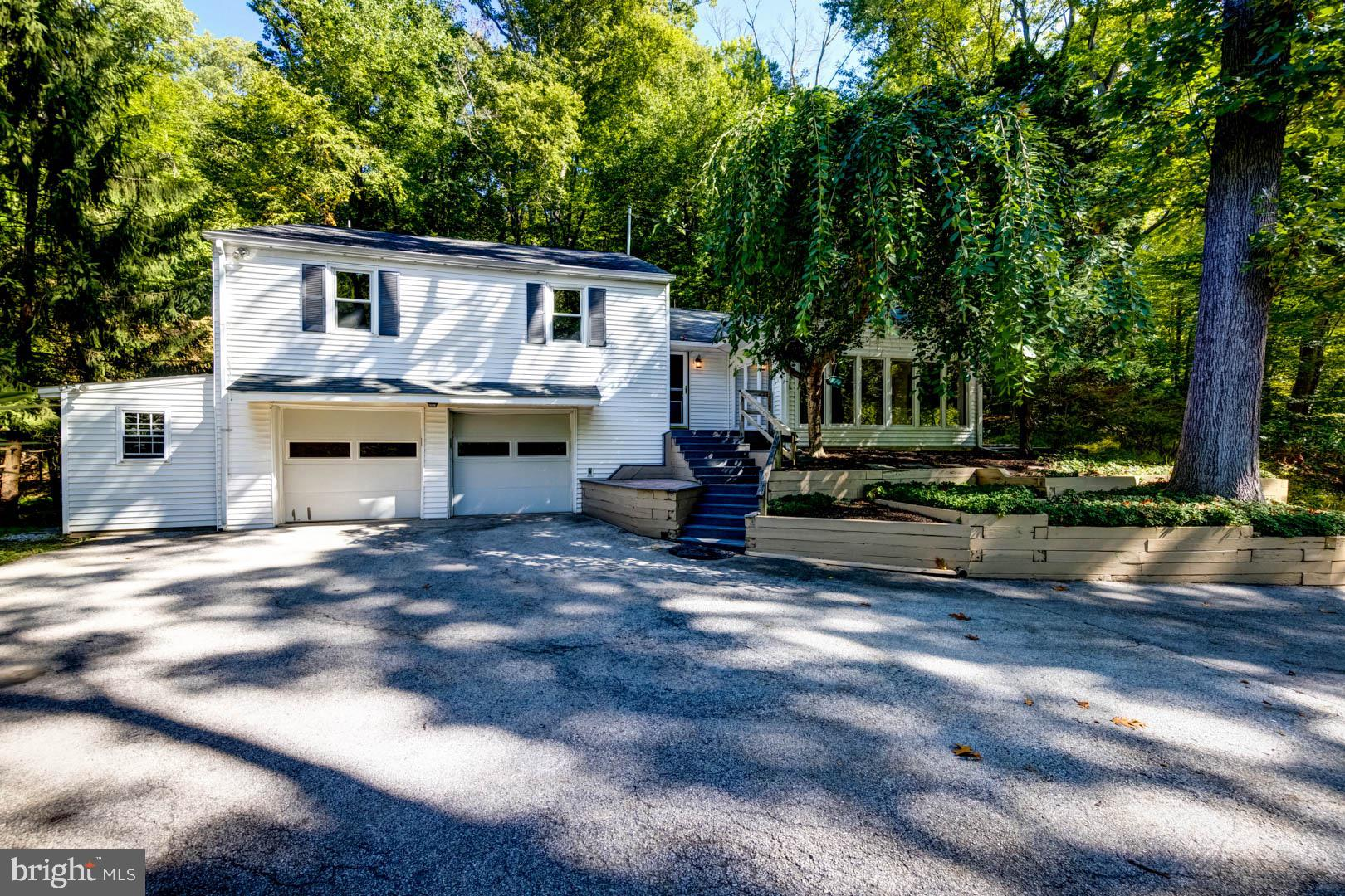 Well-maintained, move-in ready split level home on a quiet cul-de-sac offering 3 bedrooms, 2.5 baths, and a 2-car garage on two secluded parcels totaling 1.55 acres adjacent to Crabby Creek Park, 48 acres of open space owned by Tredyffrin Township.  A composite landing off the front steps leads to a welcoming foyer with hall closet. The main level includes: spacious living room with hardwood floors and a gas fireplace with brick surround; dining room with crown molding, chair rail, and door to the rear patio; eat-in kitchen with tasteful wood cabinetry, white appliances, solid surface countertop, and tile backsplash. Off the living room is gorgeous glass-enclosed sunroom with vaulted ceiling, skylights, and a wall of casement windows providing wonderful views of the scenic environs. The primary bedroom has hardwood floors, two closets, and a full bathroom with tile floor.  Two secondary bedrooms with ample closet space and hardwood floors and a full hall bathroom complete the second level. The lower level, which is still above grade, has a family room, half bathroom, storage closet, and access to the two-car garage.  The unfinished basement is accessed through the garage and offers tremendous storage space.  Outside you'll find several hardscaped patios, a storage shed adjacent to the garage, and lots of mature specimen plantings.  This wonderful property is located minutes from shopping, dining, parks, major commuter routes, the Septa Regional Rail, the Village of Berwyn, and is part of the top rated Tredyffrin-Easttown School District.