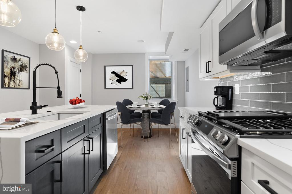 Welcome to Passyunk place, exciting new construction condos in the heart of Passyunk square. These units are bi-level with an open floor plan and lots of natural sunlight. Features include wide-plank hardwood floors, custom Kitchen cabinets, quartz countertops, and recess lighting, home entertainment package, and ring doorbell. Walk into the main floor and you will find a living area with a kitchen and full bath and backyard. The basement is fully finished with a full bath also. This location is very walkable to local restaurants, shopping, and parks.