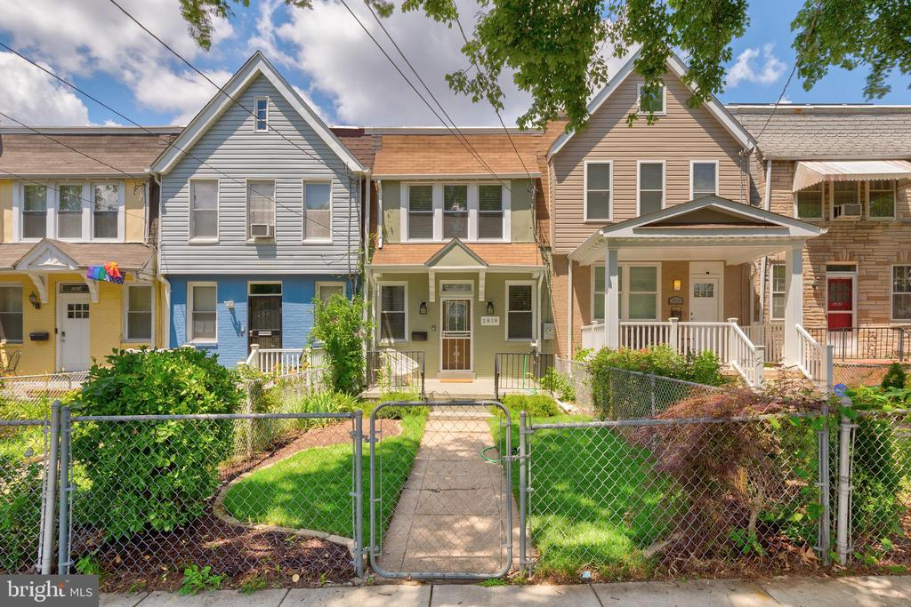 OPEN HOUSE: Sunday, June 20th, 1:00 - 3:00 pm. Nestled on a quiet, idyllic tree lined street, welcome home to this amazing 3 bed/2.5 bath home in the heart of vibrant Edgewood. As you walk into this open first floor you are met with an abundance of living space with separate dining, a newly upgraded kitchen, and bonus sunroom that leads you out to the expansive deck and yard. Perfect for entertaining indoors or outdoors, this home has it all. Enjoy summer and fall outside on the lush newly installed sod, let your guests enjoy the shade in the large lower deck lounge while you grill upstairs! On the second level you will find 3 bedrooms, storage, and a fully renovated bathroom. With room for that home office and then some, there is plenty of space for everyone to live comfortably.  Close to Right Proper Brewing, Tastemakers food court, Primrose, and Brookland's Finest you have some of the city's best just a short jaunt away. Also nearby outdoor spaces like the Edgewood Recreation Center gives that extra space to play and roam. There is 250,000 square feet of new retail space being built just moments away, which will include a pedestrian plaza, a dog park, and access to the Rhode Island Avenue Metro ramp. With a walk score of 73 and a Bikers Paradise Score of 90, this home is amazing for those seeking a quiet but accessible city living option.
