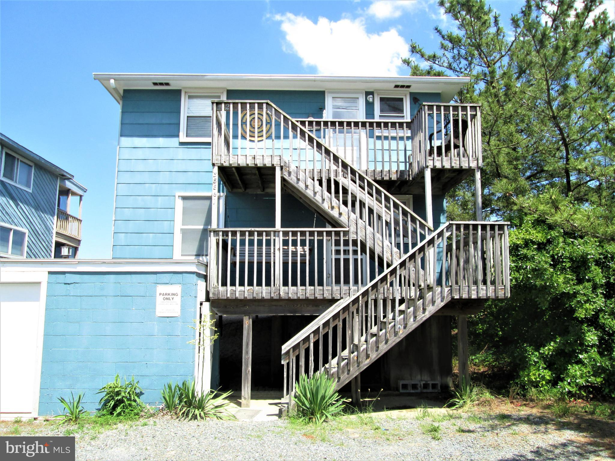 Lower unit of a duplex which is part of a six unit Association, Fenwick Dune.  Located on the ocean front.  Enjoy the soothing sounds of the waves that are only a stones throw away.  Walk off the large open deck directly on to the dune crossing. This unit is rented on a weekly basis summer of 2021 so showings must be on Saturdays between 10 am and 2:00 pm.