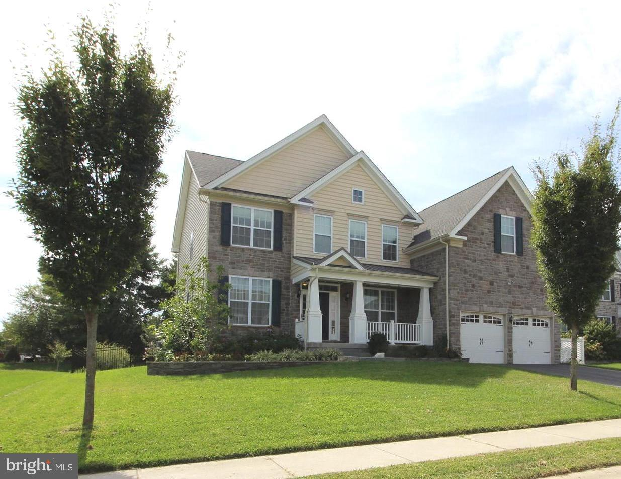 """Don't miss this spectacular 4 bedroom, 4.5 bath home in this beautiful Toll Brothers community!  This home has been upgraded throughout with a 3' bump out in the FR, over the garage for the MBrm and added basement space, 9' ceilings, Sun Room Addition and finished walk-out lower level with a full bathroom!  As you enter this stunning home, you will see upgraded hardwood flooring throughout most of the main level along with recessed lighting, crown molding, chair rail and wainscotting.  The open floor plan is amazing with a Living Room, formal Dining Room, Main Floor Office, Den or Playroom with bow window, two-story open Family Room with loads of natural lighting, floor to ceiling fireplace, raised hearth and Powder Room.  Just wait until you see the amazing eat-in Kitchen which has been upgraded with beautiful granite, backsplash, 42"""" cabinets, upgraded stainless appliances, pantry closet, center island with breakfast bar, pull-out trash cabinet, double oven, built-in microwave and refrigerator included.  The convenient Laundry Room has built-in cherry cabinets, granite at the sink area and ceramic tiled floor.  The Sun Room addition leads you to the custom brick paver patio with firepit and built-in seating, fenced yard and private views.  The second floor has upgraded carpet, a grand MBedroom Suite  which has been bumped out over the garage with two walk-in closets, tray ceiling, private full custom upgraded bathroom with double sinks/vanities, garden tub, separate toilet room, separate desk/vanity, double shower, ceramic tile and walk-in closet.  There is another Prince or Princess Suite with private full upgraded bathroom, two additional bedrooms and another full upgraded bathroom.  The walk-out lower level is finished with a gigantic  Recreation Room, full upgraded bathroom, separate workshop and separate storage area.  The custom upgrades are too many to list here, but some other features are:  upgraded electrical system to 480 amps, alarm system, three zones"""