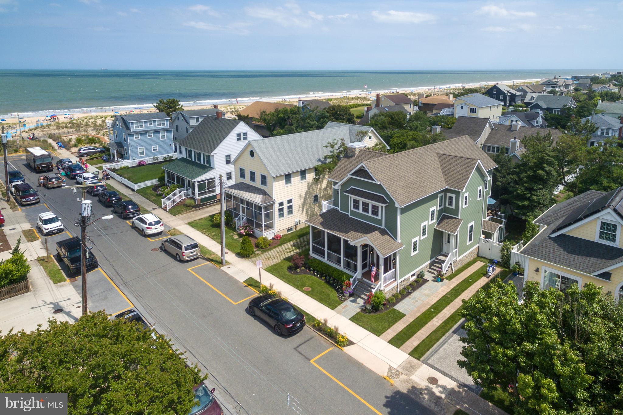"""Under Contract but available for Showings and Back Up Offers Welcome.  Experience Perfection on the much coveted Ocean Block of Stockley Street in Rehoboth Beach.  Fashioned in the spirit of a beach cottage is a charismatic blend of upscale and casually sophisticated timeless design. Completely rebuilt from the basement foundation up in 2017 this home offers every imaginable luxury finish to please the most sophisticated buyer.  Built to the highest standards, attention to detail is clearly evident with large plank bamboo flooring throughout the entire home, coffered ceilings, extensive custom molding and cabinetry, shiplap fireplace surround, Gourmet kitchen with Wolf 6 burner range and grill and professional range hood, French door refrigerator, separate built in ice-maker, 2 built-in refrigerator drawers, over-sized quartzite island with copper basin prep sink and built-in microwave, granite farm sink surrounded by quartz counters, custom cabinetry and pantry.  The rear yard is an oasis with privacy landscaping and fencing and a large deck providing the perfect environment for entertaining.  Upstairs you'll find the Primary Master Bedroom with custom walk-in closets, expansive master bath and a private balcony with stunning ocean views.  Down the hall are two additional Guest Bedrooms each with custom built-in cabinetry, a large hall guest bath, and a large laundry room.  In the rear of the home is an additional Master Bedroom with a private ensuite bath.  Additional features include HardiPlank Siding, large front screened porch, off-street parking, outdoor shower, full """"dry"""" basement, fully fenced yard, irrigation, steps to the ocean and this home is """"not"""" in a flood zone.  This ideal location within the highly coveted City of Rehoboth Beach allows for easy walking proximity to a myriad of shopping, dining and cultural offerings, as well as the mile long boardwalk and Atlantic ocean beach."""