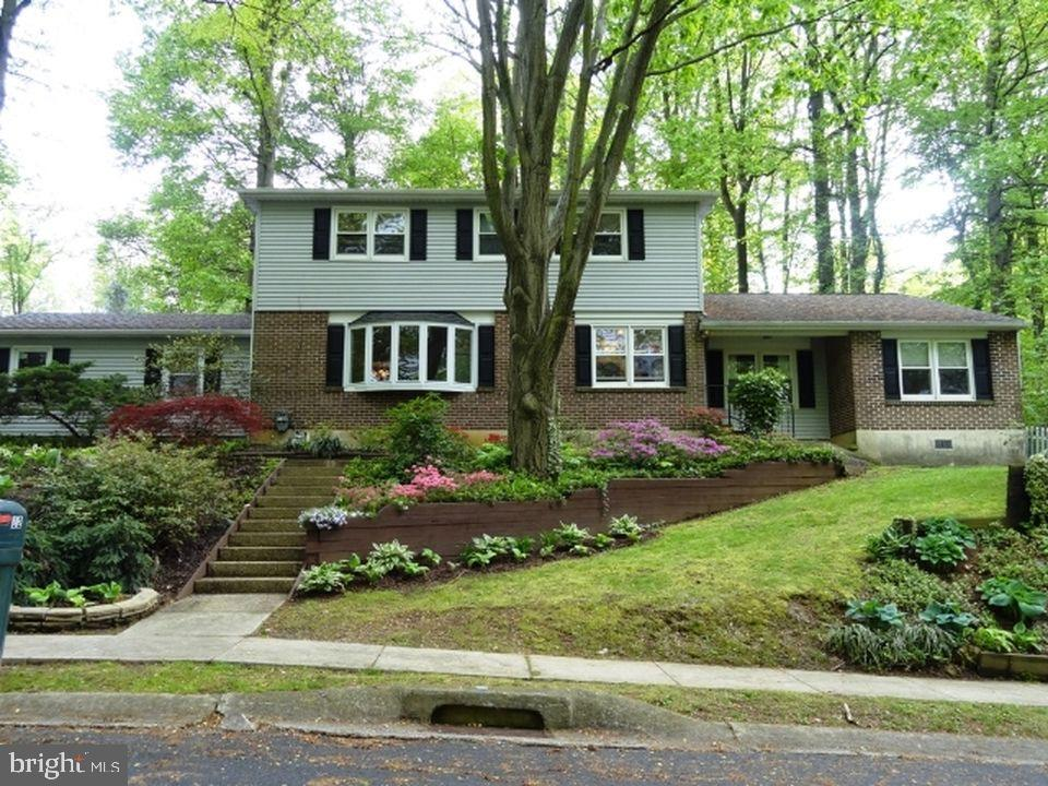 Rare opportunity to purchase your dream home in the desirable wooded neighborhood of Arbour Park! Just a short drive away from the University of Delaware campus, this location allows you to take full advantage of all Newark has to offer. This home allows the privacy and feeling of being secluded in nature, while also having the friendly neighborhood and community element. There are 4 bedrooms upstairs, accompanied by 2 full baths including one in the master bedroom.  On the main level is an eat in kitchen, dining room, and living room with large bow window.  On the other side of the home, still on the main level, is an in-law suite with another full bath, a large bedroom that is divided into a sleeping area, and  what could be a lounge, office, or whatever you want to make it! 2 car garage, sunroom, and a partially finished basement with another bedroom and full bath means there is plenty of house to go around! Beautiful hard wood floors cover most of the main level, and an awesome, traditional, brick fire place adds even more character to the home . The terrace gardens in the front and back provide endless gardening options, and will allow the florist/farmer in you to flourish!  ***DISCLOSURE*** The pictures of the gardens do not represent the current condition, as they are only meant to help you visualize the potential.