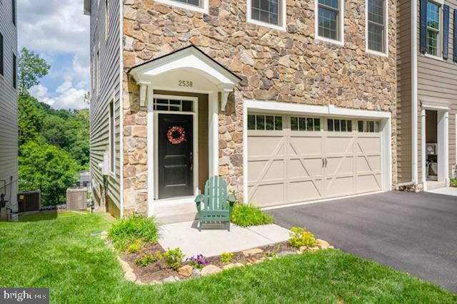 Here is your chance to own an (almost) new home in the classic neighborhood of historic Highlands and Rockford Park. Built by the award-winning Montchanin Builders in 2019, this luxurious, end-unit townhome offers beautiful views overlooking Rockford Falls, the Brandywine River and the Alapocas Greenway and rock climbing wall! Truly an OPEN CONCEPT floor plan with loads of natural light, this home boasts 10' ceilings on the main level (2nd floor) and a gourmet kitchen with designer cabinetry, oversized island, granite countertops and stainless steel appliances (all included). The upper level (top floor) also boasts 9' high ceilings and a laundry room with washer/dryer included, convenient to the upper level bedrooms. There is also a pocket office with custom built-in desk and cabinetry with a modern barn door. At the entry level, you are greeted with 9' high ceilings and hardwood flooring and an oak staircase with painted risers and iron spindles, a modern twist on classic architectural features appropriate for this neighborhood! There is an entry level bedroom (no steps) including it's own bath and private den or family room which could also serve as a home office, play room or hobby room. The unfinished basement has doors to a full walk out to the rear yard and could easily be finished for bonus space, a workout room, home office or simply storage. Natural gas heating, high efficiency Jeld-Wen windows, concrete siding and stone provide an energy efficient home. Low maintenance living since all of the common areas, individual lawn and beds are maintained by the association for a low monthly fee. Ideally located within walking distance to Trolley Square shopping, restaurants, hospitals, Rockford & Brandywine Parks, the Delaware Art Museum nearby and with easy access to all major highways, this location really is ideal.