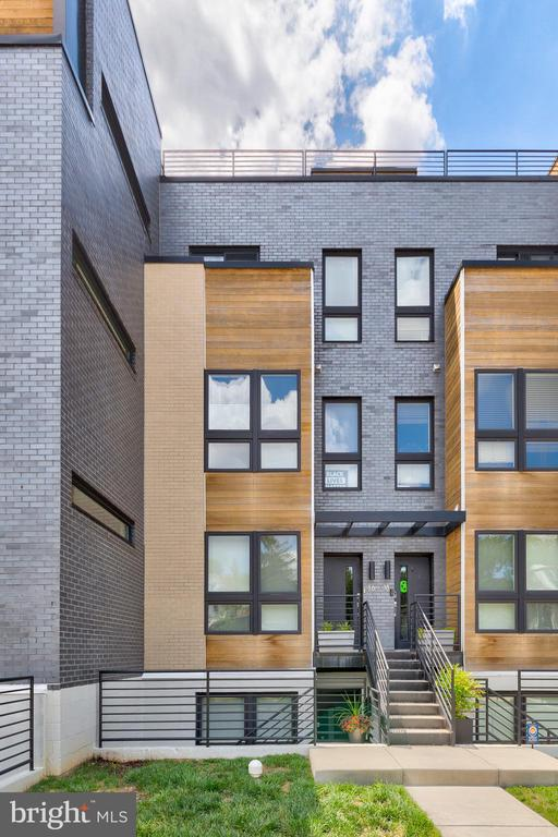 STUNNING New Listing at Brooks Row! This 2017 build modern boutique condo building is located in the heart of Brookland at 12th/Franklin St NE. Easily enjoy Noyes Park, community gardens, the Arts Walk, the Farmers' Market and local dog parks. Walking distance to the Red Line Metro and Brookland Hot Spots such as: Menomale, Dew Drop Inn, Brookland's Finest, Primrose, and Masala Story. Step inside this freshly painted 2-bedroom, 2.5-bath two-level condo and you will find approximately 1,286 square feet of living space with a bright and airy open main living area, oak hardwood flooring throughout, and a chef's kitchen with white quartz counters, huge island and stainless-steel appliances. Highlighted  features offered with this gorgeous property include custom closets and window treatments, a quaint rear patio, and the ONLY unit to have covered parking with extra storage space beside it. Please note: builder's floor plan when new showed 1,286 sq. ft.; public tax record shows 1,044 sq. ft.