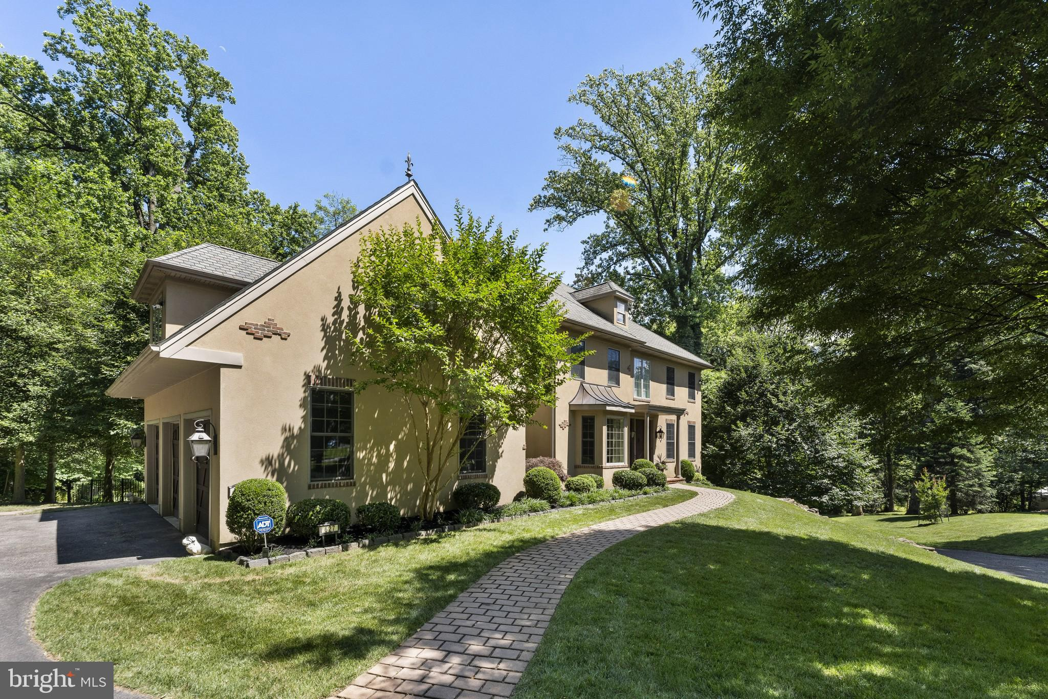 Welcome to 627 Broad Acres Road in highly sought-after Penn Valley and Lower Merion School District. This gorgeous custom-built French Colonial sits on a quiet, interior lot, and features a three-car garage, a stunning pool and spa, and beautifully manicured grounds. The formal Living Room with a fireplace, luxury wainscotting, and crown molding, lies opposite the formal oversized Dining Room, with a bay window drenching the room with natural light. The home features a phenomenal gourmet kitchen with matching wood fronts on appliances, custom luxury cabinetry, double wall ovens, custom-cut granite countertops, tile backsplash, a huge island with a warming drawer, and hanging lights, and a hand-stamped farmhouse sink. A Butler's Pantry with a wine cooler lies between the dining room and kitchen. The kitchen flows into the Great Room with a second majestic fireplace, coffered ceilings with recessed lighting, and plenty of space for family nights or get-togethers. The home also features a first-floor study, perfect for today's environment. Moving to the second floor, the sumptuous Master Quarters have vaulted ceilings, his and her oversized walk-in closets with shelving, a sitting area being used as a sauna room, and a Master Bath that is spacious, lavish, and filled with upgrades. Featured on the second floor are three additional generously sized bedrooms, one with a full bathroom, along with one hallway bathroom. The finished walk-out basement is an incredible amenity as well, with its spaciousness, recessed lighting, natural light, powder room, and bedroom area. The back exterior of the property is truly an oasis. The home features a custom-heated saltwater pool and spa, a rarity among similar properties. This home offers every amenity possible for extraordinary living: wainscotting, whole house vacuum, exterior electric dog fence, full house sound system, second-floor laundry, all in an extremely sought-after area known for its luxury and convenience. Come see this