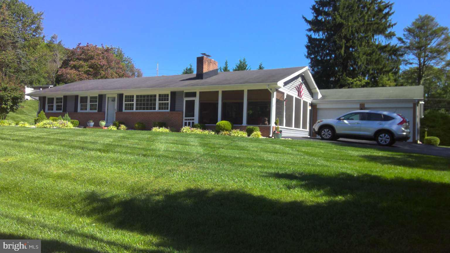 3Bd/2.5bath ranch w oversize 2 car garage, .78 acre lot. Move-in ready, partially fenced yard, screened porch with paddle fans and shades, access to garage and yard. LR w wood fireplace and glass door screen, crown molding, dining area. Kitchen has cherry cabinets, Corian counter tops, LG appliances. 3 bdrms, full bath w/shower enclosure, updated 1/2 bath off master. Lower level renovated w/large stacked stone, granite top bar and counter with sink, 2 wine coolers, upper and lower cabinets with mounted flat screen TV. Family area with mounted TV in stacked stone accent wall. Additional finished room can be used as game room or bedroom. Full bath w/jacquzzi tub, large vanity, linen closet. Unfinished section for storage, separate closet w/Samsung washer/dryer.
